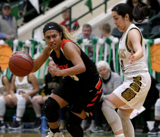 Burkburnett's Eternity Jackson dribbles by Synder's Nicole Martinez in the Region I-5A bi-district round of the playoffs Monday, Feb. 11, 2019, at the Breckenridge ISD Athletic and Fine Arts Center. The Lady Bulldogs defeated the Lady Tigers 55-54.