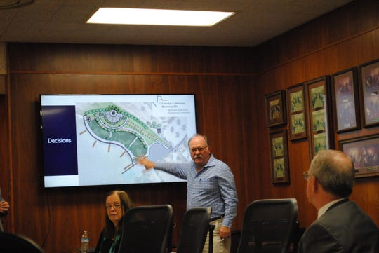 David Powell, engineer with the city of Wichita Falls, talks about design changes to the veterans memorial plaza and Kemp Street boat ramp Tuesday during a Lake Wichita Revitalization Committee meeting.