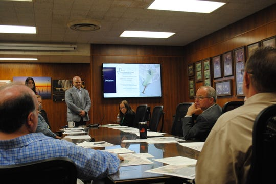 John Field, Lake Wichita project manager with Kimley-Horn, and Katelyn Grass, discuss design cost estimates Tuesday with the Lake Wichita  Revitalization Committee.