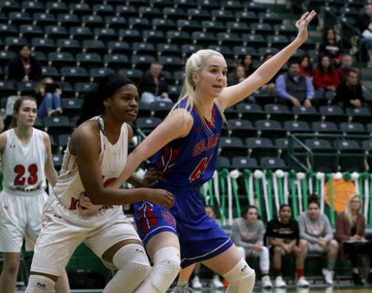 Graham's Cammie Teplicek calls for the ball by Sweetwater's Shavie Green in the bi-district playoffs at the Breckenridge Athletic and Fine Arts Center.
