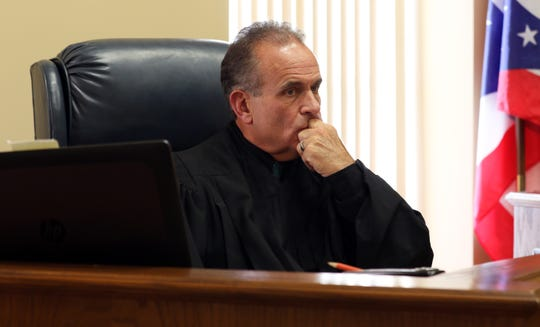 Muskingum County Common Pleas Court Judge Kelly Cottrill listens while presiding over POWER Court recently. POWER Court is an intensive program designed to keep drug offenders out of jail while providing support for their recovery.