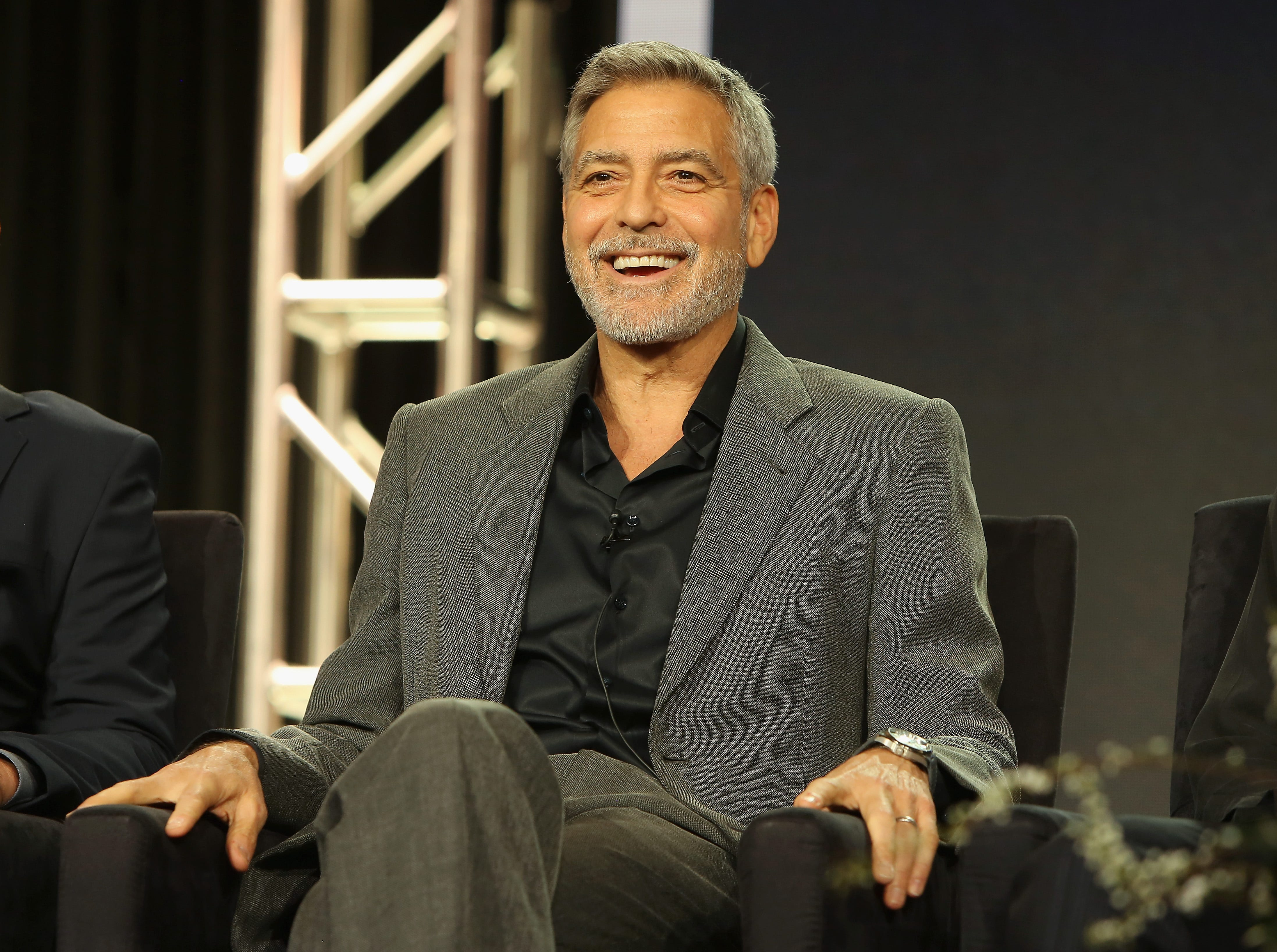"""It's time for the Television Critics Association's winter press tour in Pasadena, Calif., where networks present their shows to TV journalists. Here, George Clooney laughs during Hulu's """"Catch 22"""" panel."""