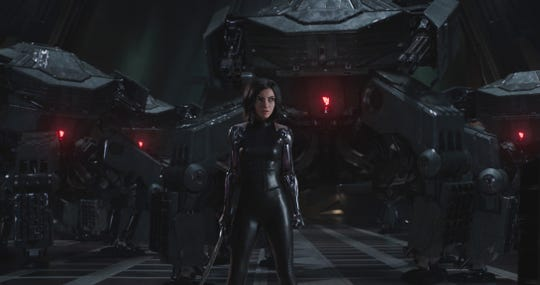 "Alita (Rosa Salazar) gets ready to whup a bunch of machinery in ""Alita: Battle Angel."""