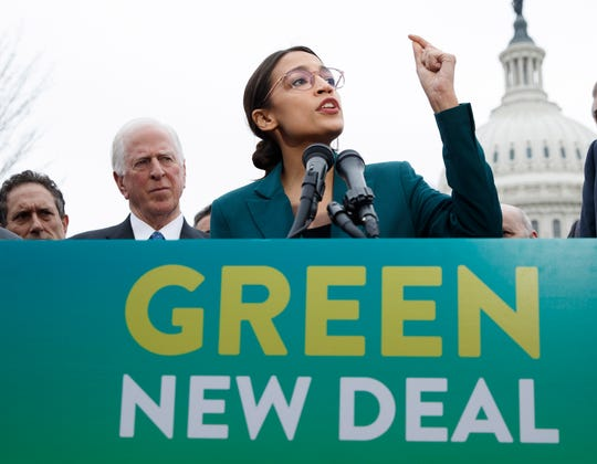 Rep. Alexandria Ocasio-Cortez, D-N.Y., with Sen. Ed Markey, D-Mass., delivers remarks on the Green New Deal resolution during a press conference on Capitol Hill in Washington, on Feb. 7.