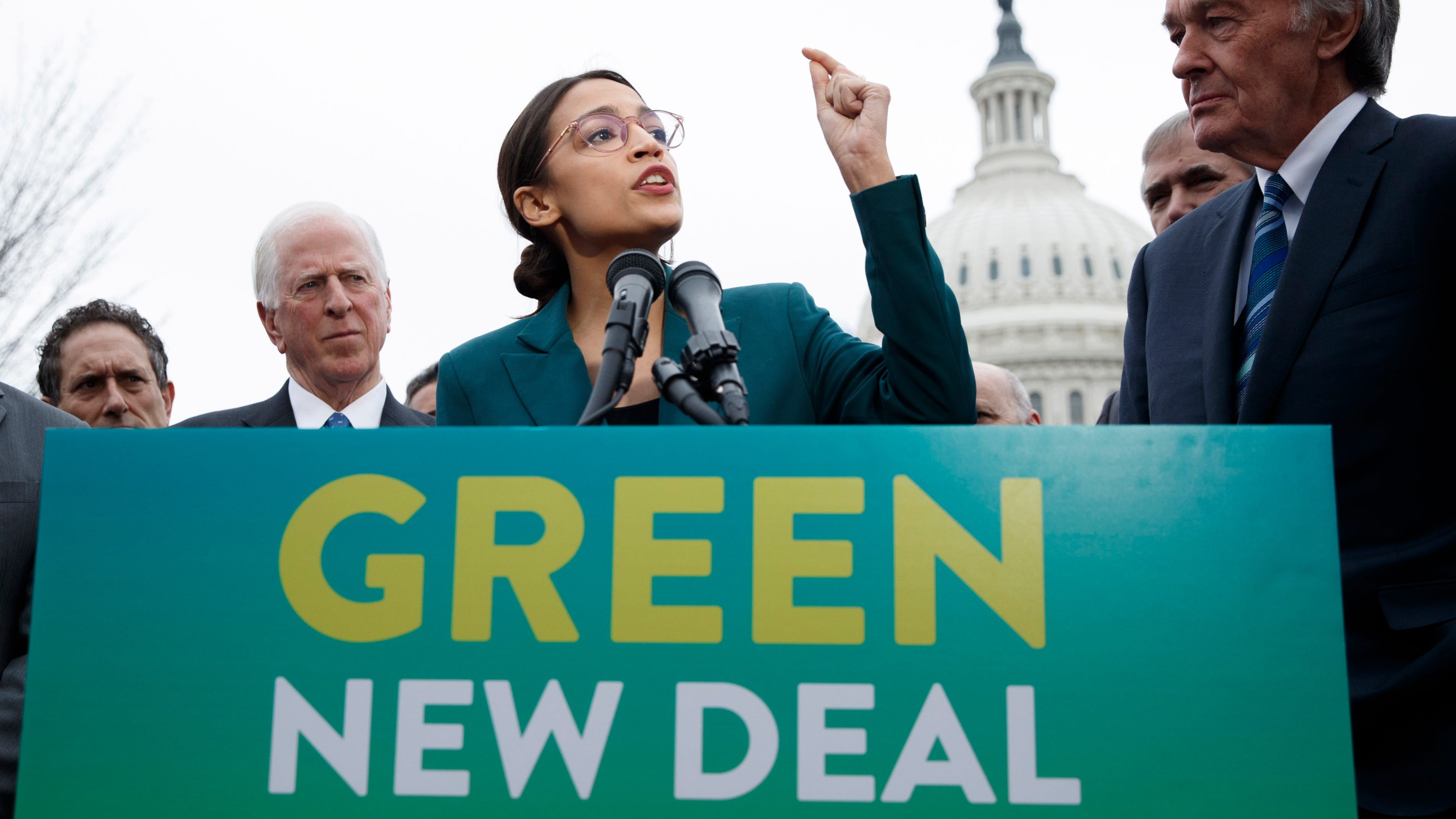 Rep. Alexandria Ocasio-Cortez, D-N.Y., with Sen. Ed Markey, D-Mass.,  delivers remarks on the Green New Deal resolution during a press conference on Capitol Hill in Washington, on Feb. 7, 2019.