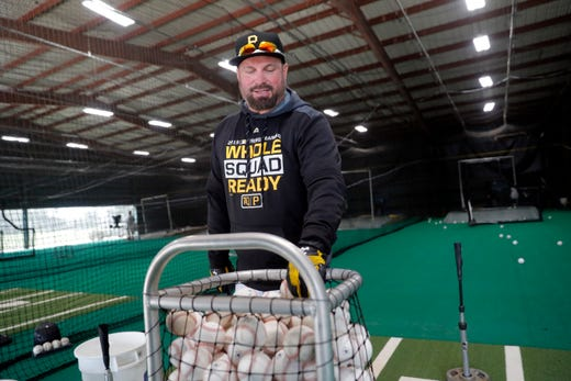 Feb. 12: Country music recording artist Garth Brooks works out in a batting cage.