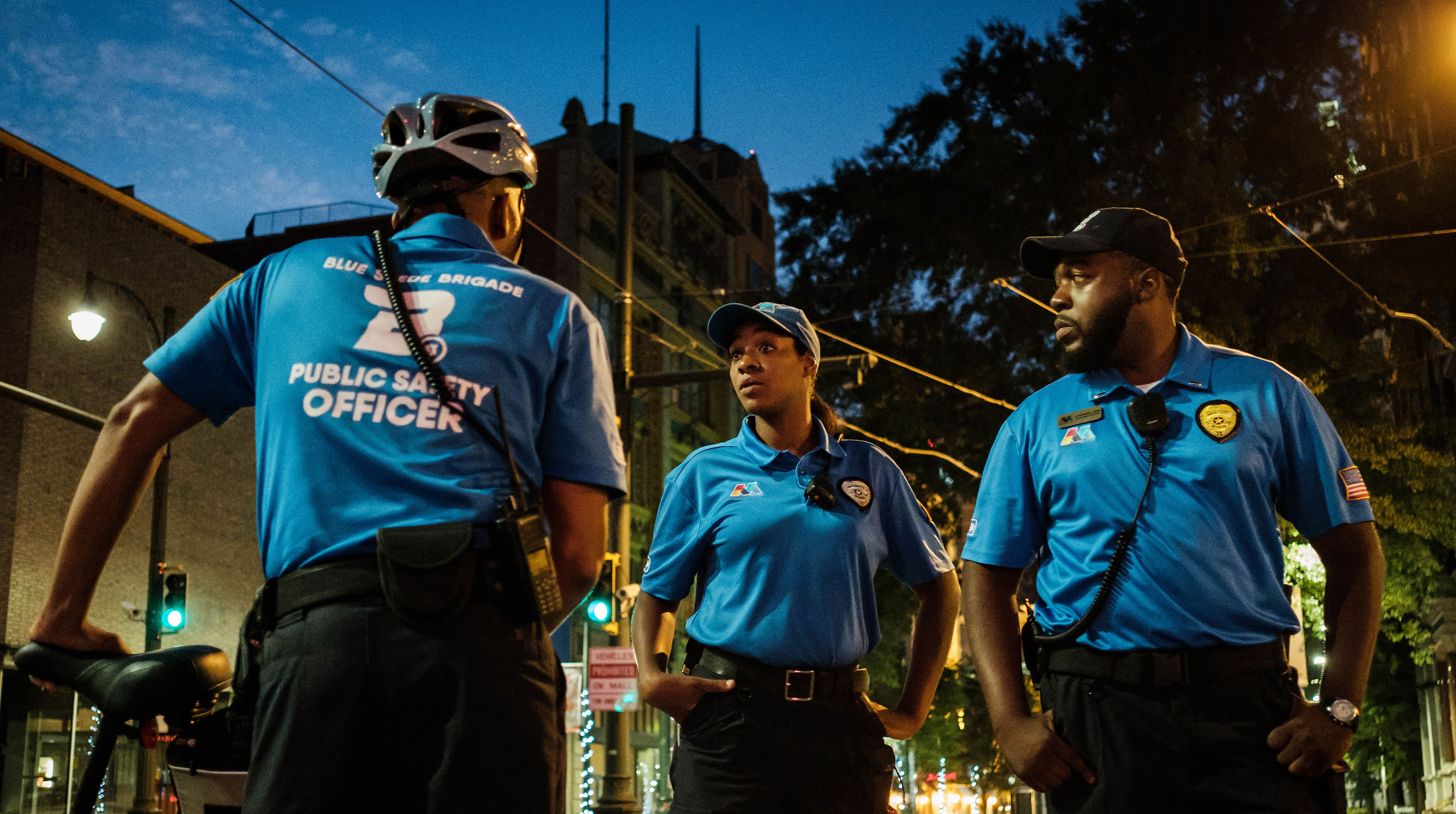 In response to a reduction in police officers, the Blue Suede Brigade, a private security force, patrols the tourist areas in Memphis. From left, Blue Suede Brigade members Kcbena Cash, Tamala Johnson and Nathaniel Lewis worked the night shift.