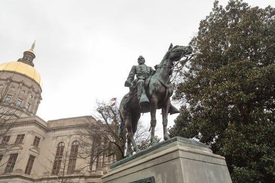 A statute of Confederate Gen. John Brown Gordon guards the Georgia Capitol.