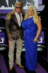 """Duane """"Dog"""" and Beth Chapman on the red carpet during the 2013 CMT Music Awards."""