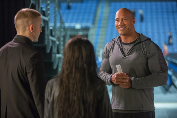 "Dwayne Johnson (right) stars as himself in the pro-wrestling biopic ""Fighting With My Family."""