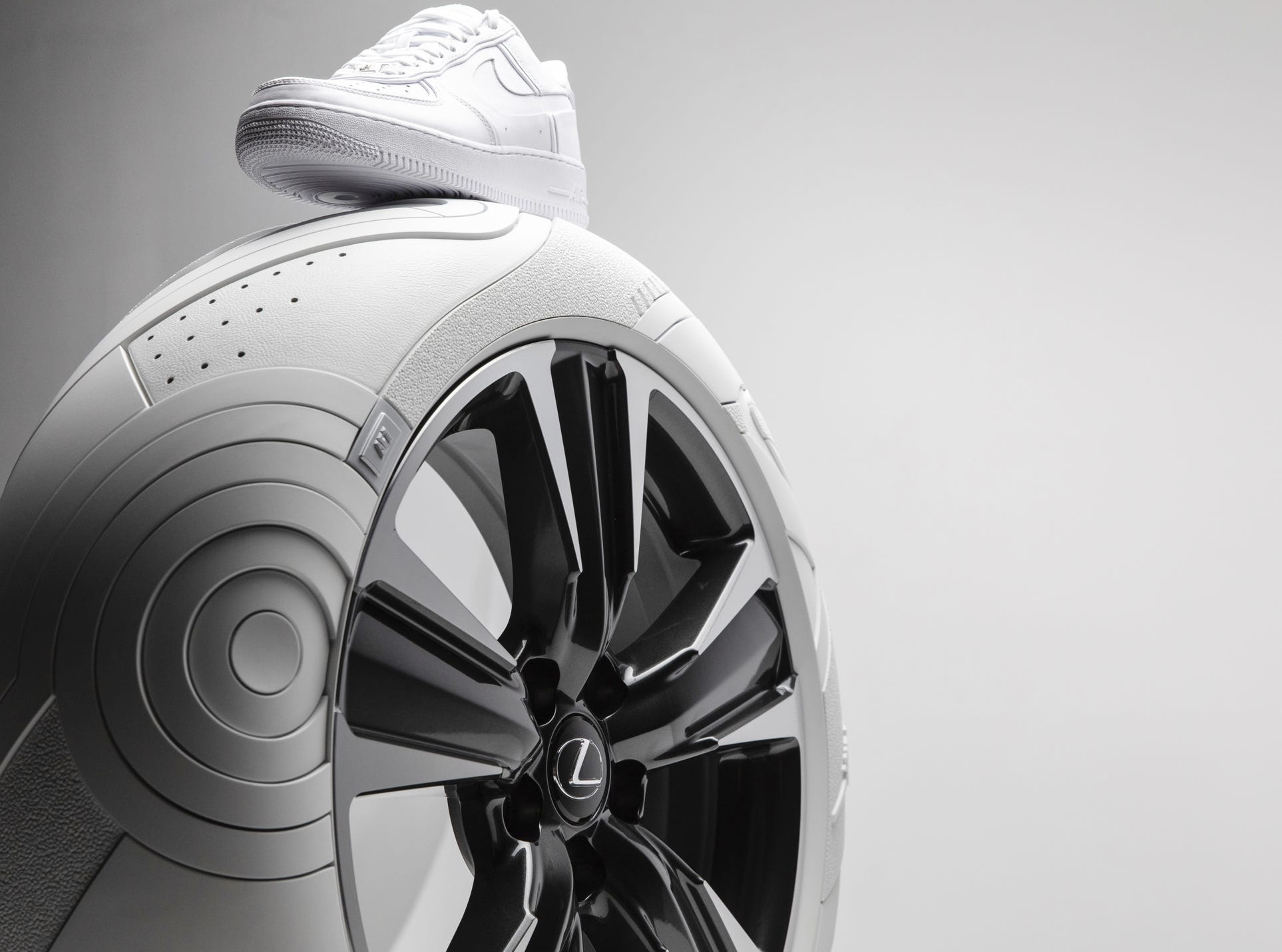 Nike's Air Force 1 sneaker atop Lexus UX custom tires