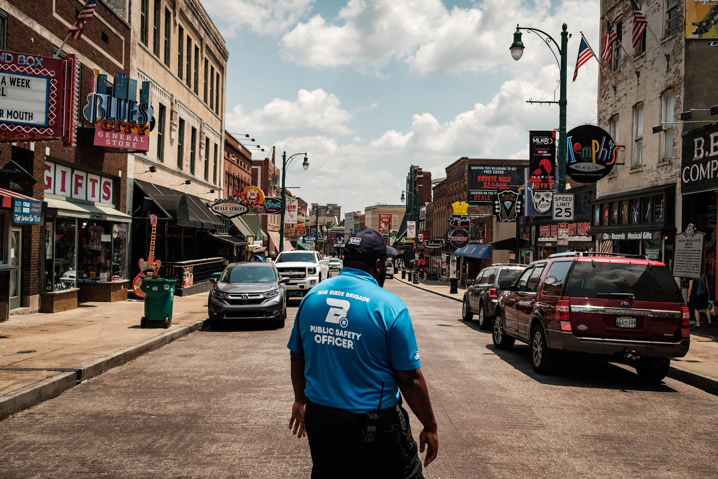 Capt. Eleslie Walker of the Blue Suede Brigade, a private security force, makes his way down Beale Street, a popular tourist destination in downtown Memphis.