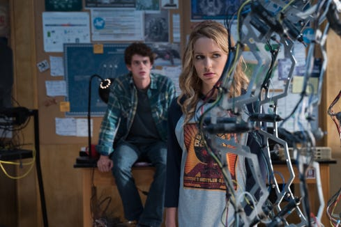 """Tree (Jessica Rothe, with Israel Broussard) eyes the machine that's totally messing up her life in """"Happy Death Day 2U."""""""