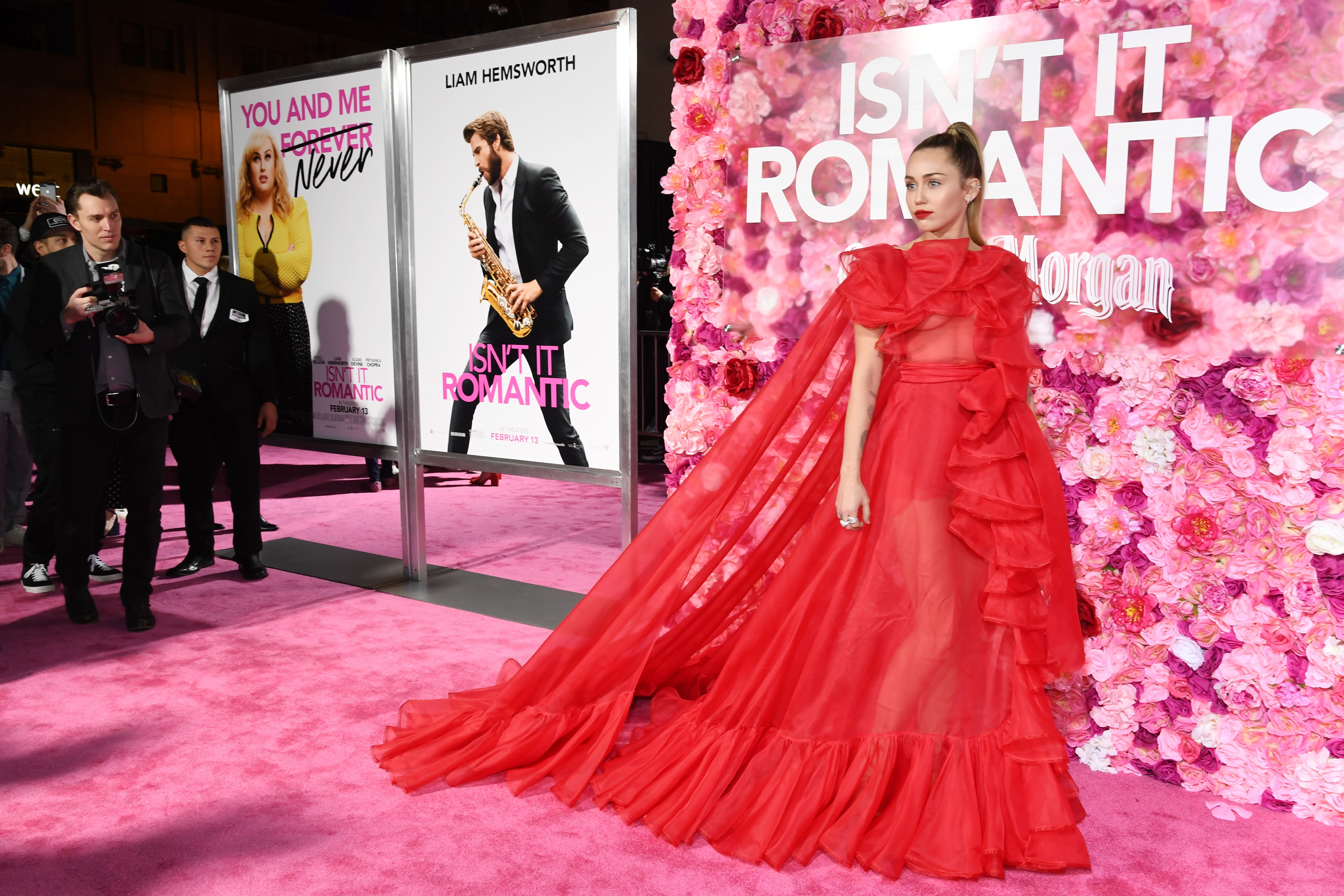 Miley Cyrus steps in for hospitalized Liam Hemsworth at 'Isn't It Romantic' premiere