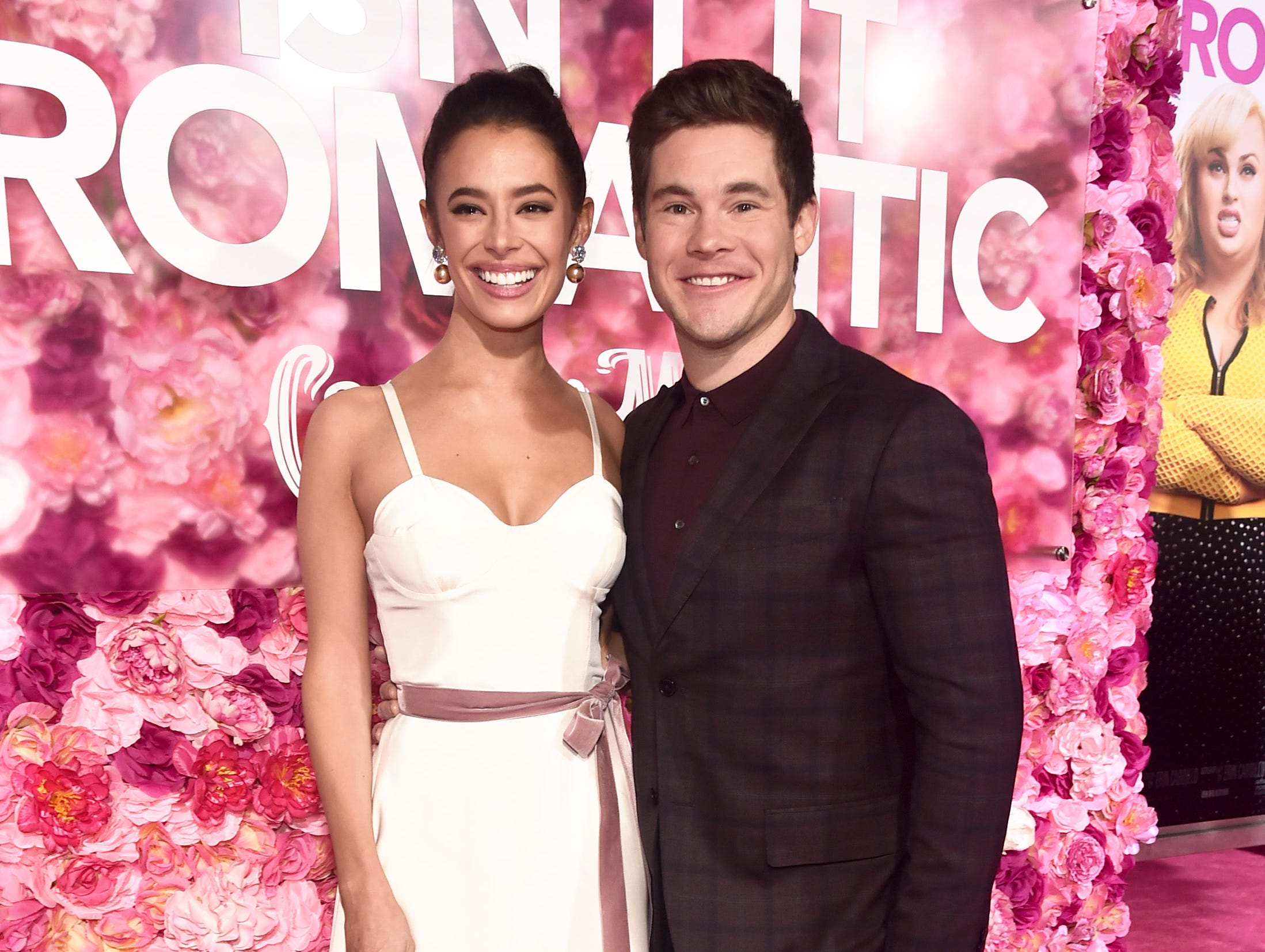 "LOS ANGELES, CALIFORNIA - FEBRUARY 11: (L-R) Chloe Bridges and Adam DeVine attend the premiere of Warner Bros. Pictures' ""Isn't It Romantic"" at The Theatre at Ace Hotel on February 11, 2019 in Los Angeles, California. (Photo by Alberto E. Rodriguez/Getty Images) ORG XMIT: 775292839 ORIG FILE ID: 1129041010"