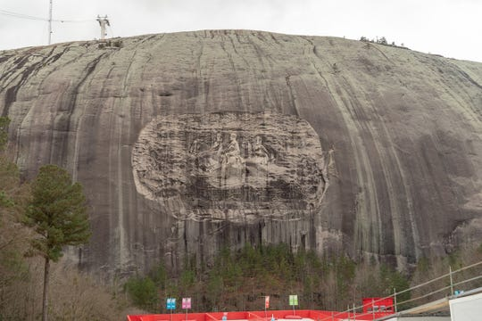 The massive bas-relief at Georgia's Stone Mountain honors Confederate President Jefferson Davis and Gens. Robert E. Lee and Stonewall Jackson. Fifteen white men chose the site in 1915 to establish the second Ku Klux Klan.