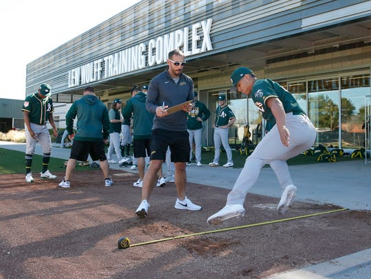 Athletics pitchers perform tests during spring training at the Lew Wolff Training Complex.