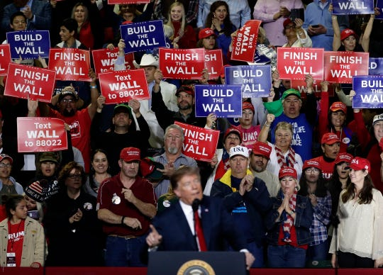 People cheer as President Trump speaks at a rally at the El Paso, Texas.