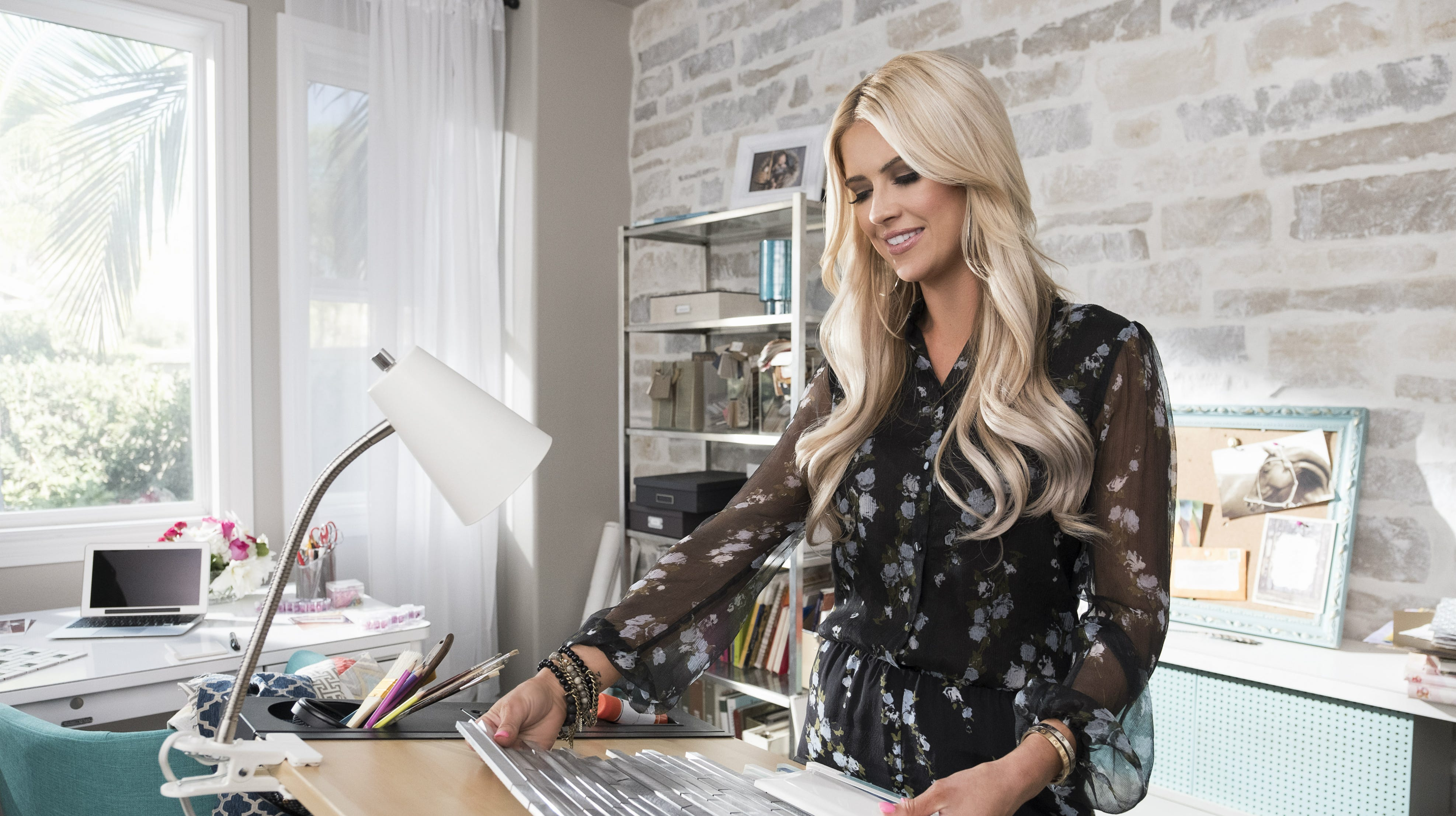 """Christina Anstead has a new HGTV show, """"Christina on the Coast,"""" which follows her design business and her life after splitting with her """"Flip or Flop"""" co-star and ex-husband, Tarek El Moussa."""