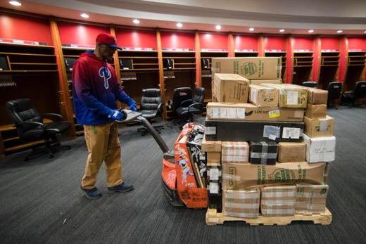 Feb. 8: A worker hauls a load of Phillies' baseball from the clubhouse, destined for spring training in Clearwater, Fla..
