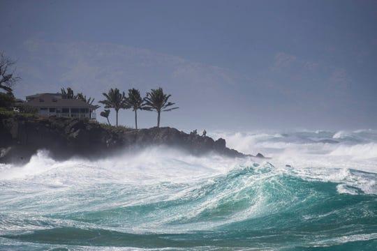 Rough surf hits Oahu's Waimea Bay near Haleiwa, Hawaii, on Sunday.