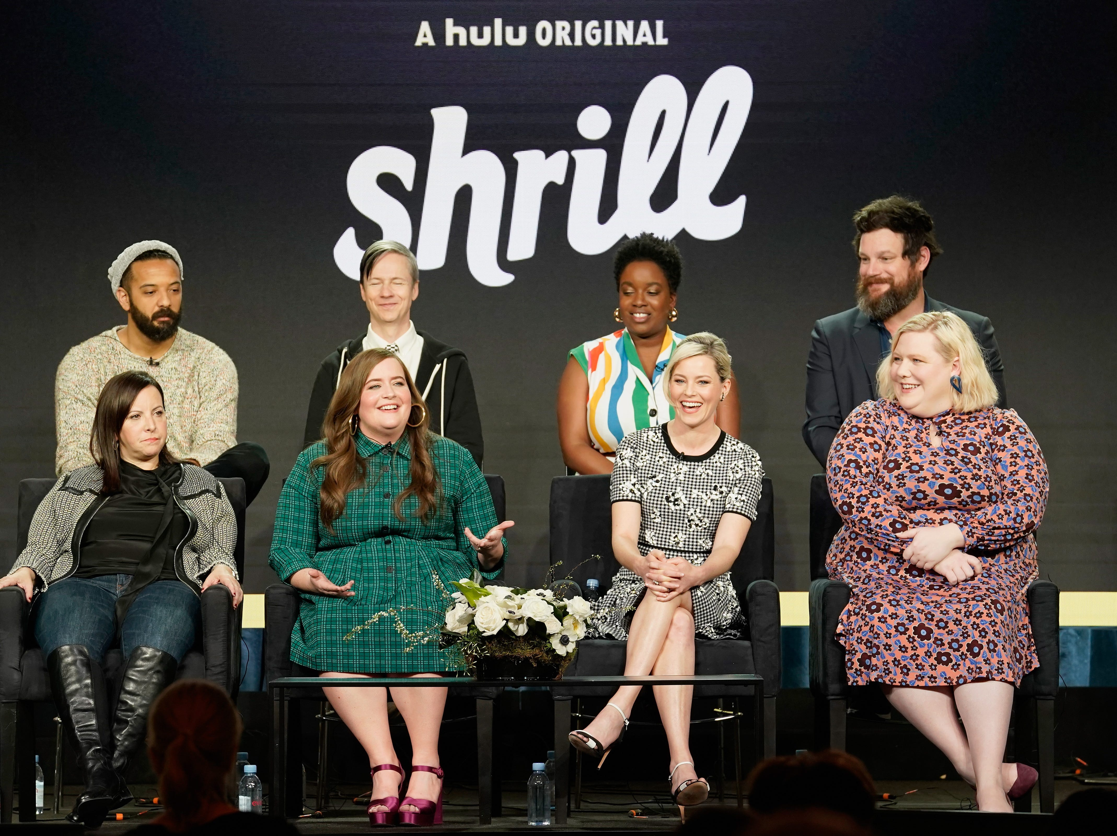"""The cast of Hulu's """"Shrill"""" -- Ian Owens, Ali Rushfield, John Cameron Mitchell, Aidy Bryant,  Lolly Adefope,  Elizabeth Banks, Lindy West and Luka Jones -- talk about their new show."""