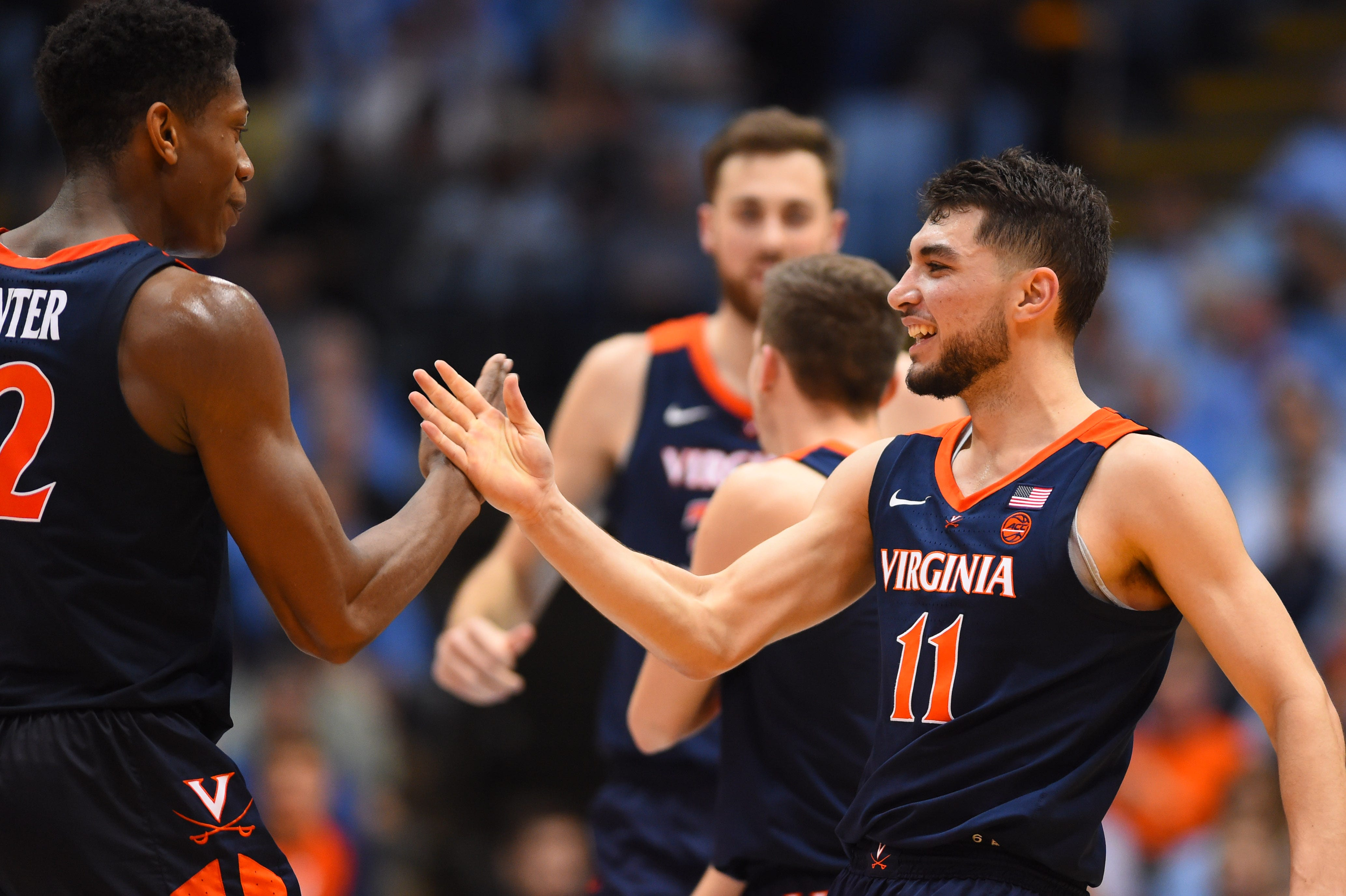 Virginia guards De'Andre Hunter (left) and Ty Jerome (11) react in the second half at Dean E. Smith Center.