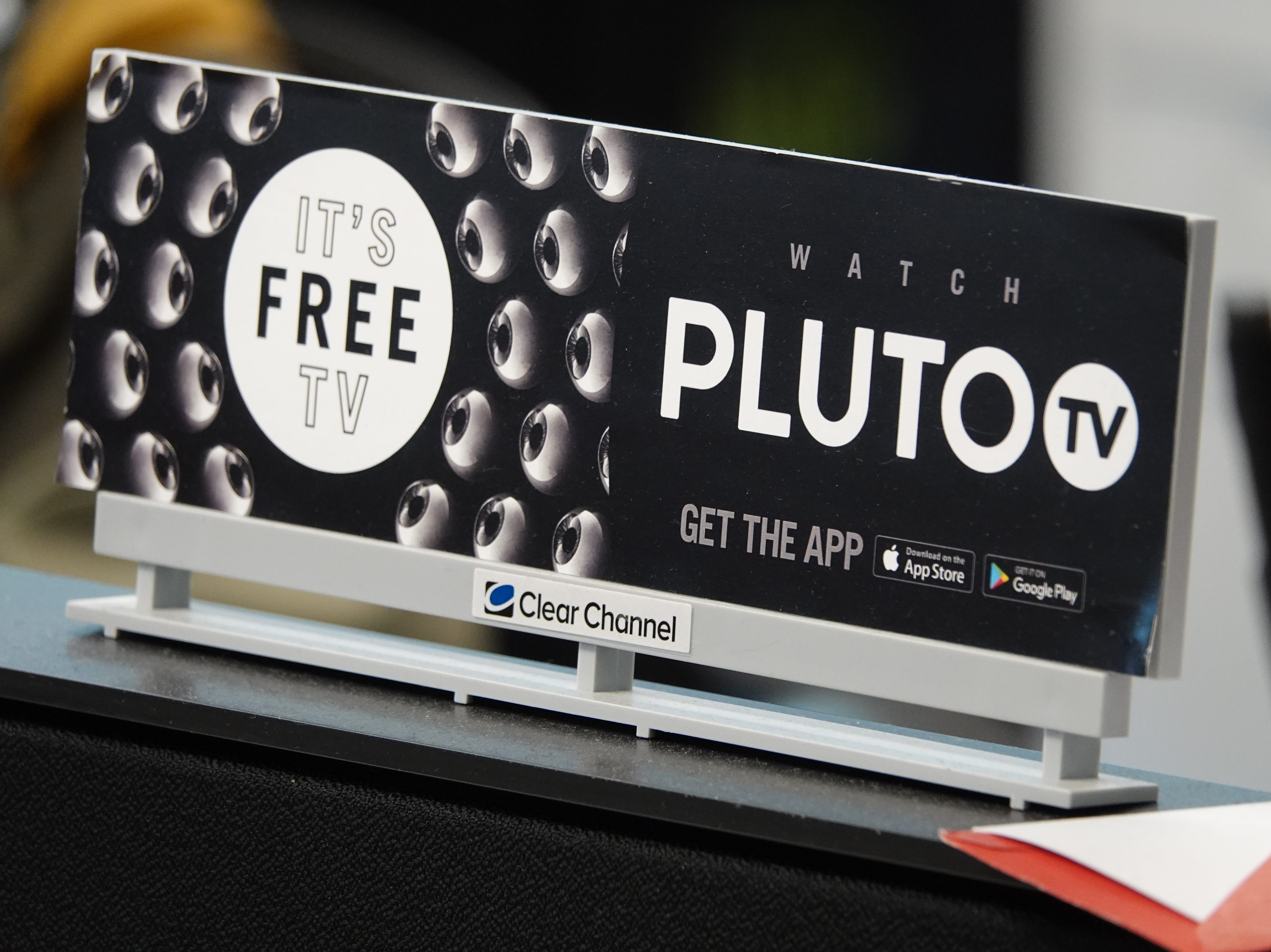 A Pluto.TV billboard points out that programming is free with the app