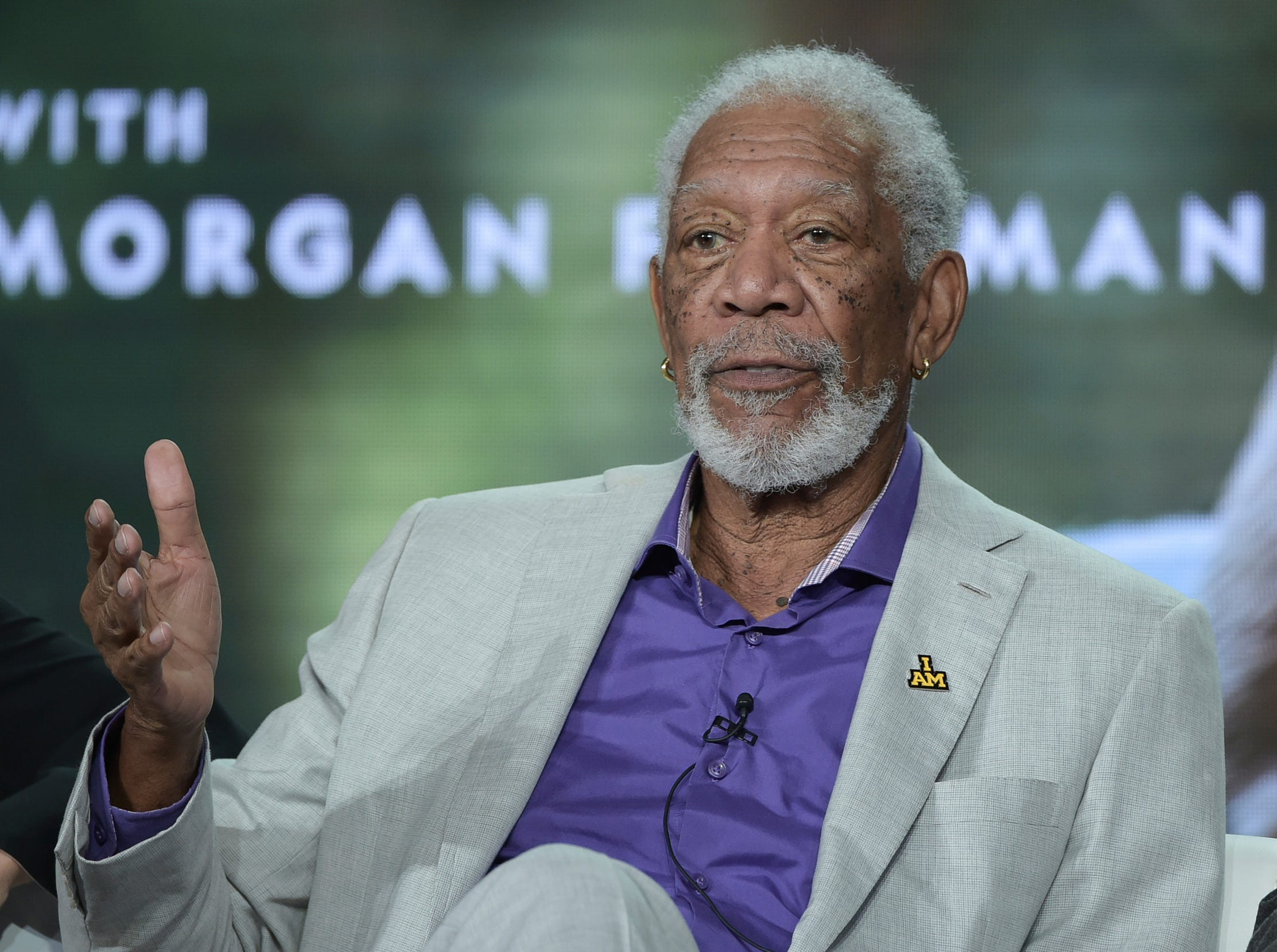 """Morgan Freeman talks during the """"Story of God"""" panel during the National Geographic."""