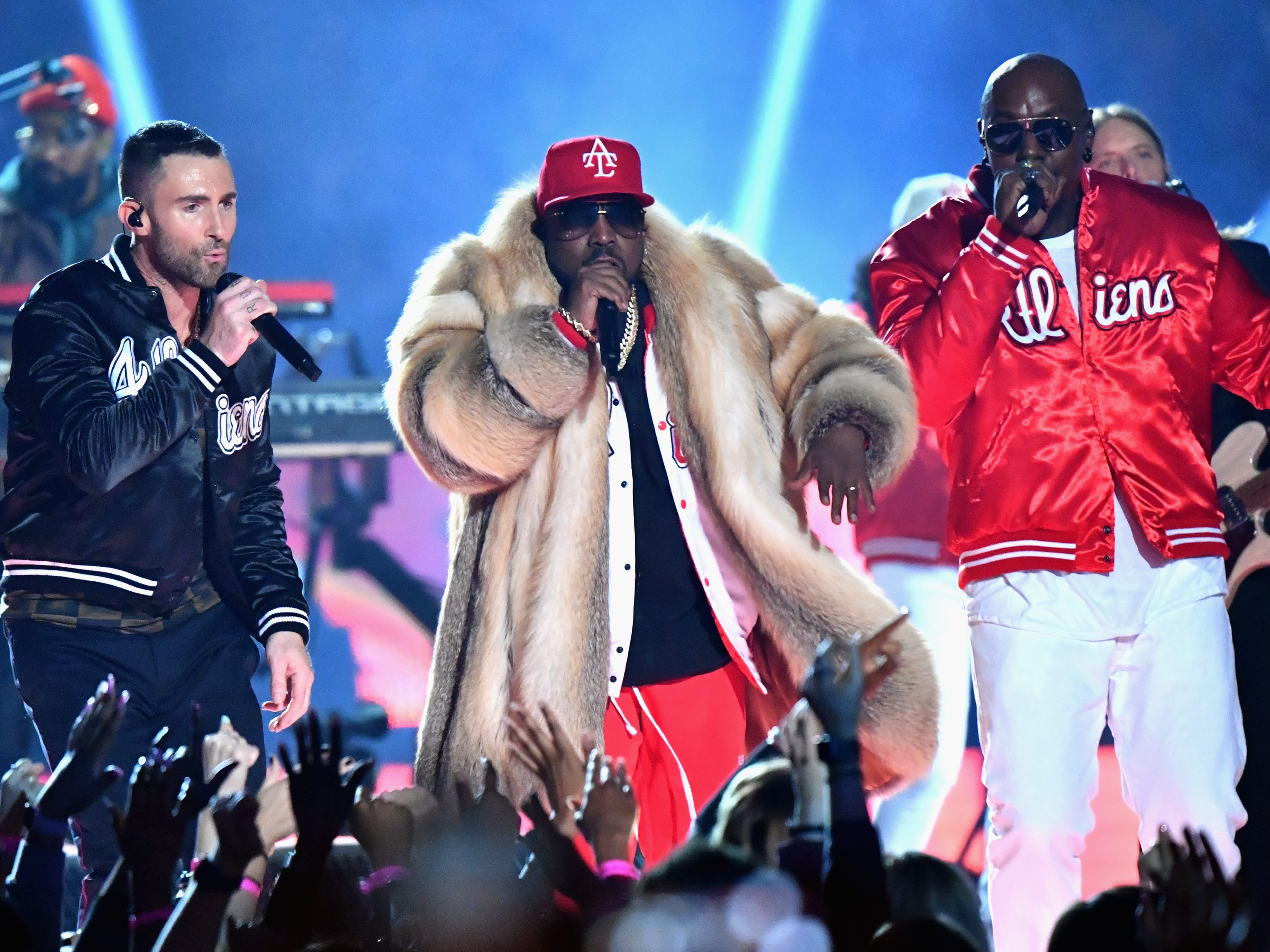 Adam Levine is joined by featured performers Travis Scott, center, and Big Boi of Outkast during Maroon 5's Super Bowl halftime show in Atlanta on Feb. 3, 2019.