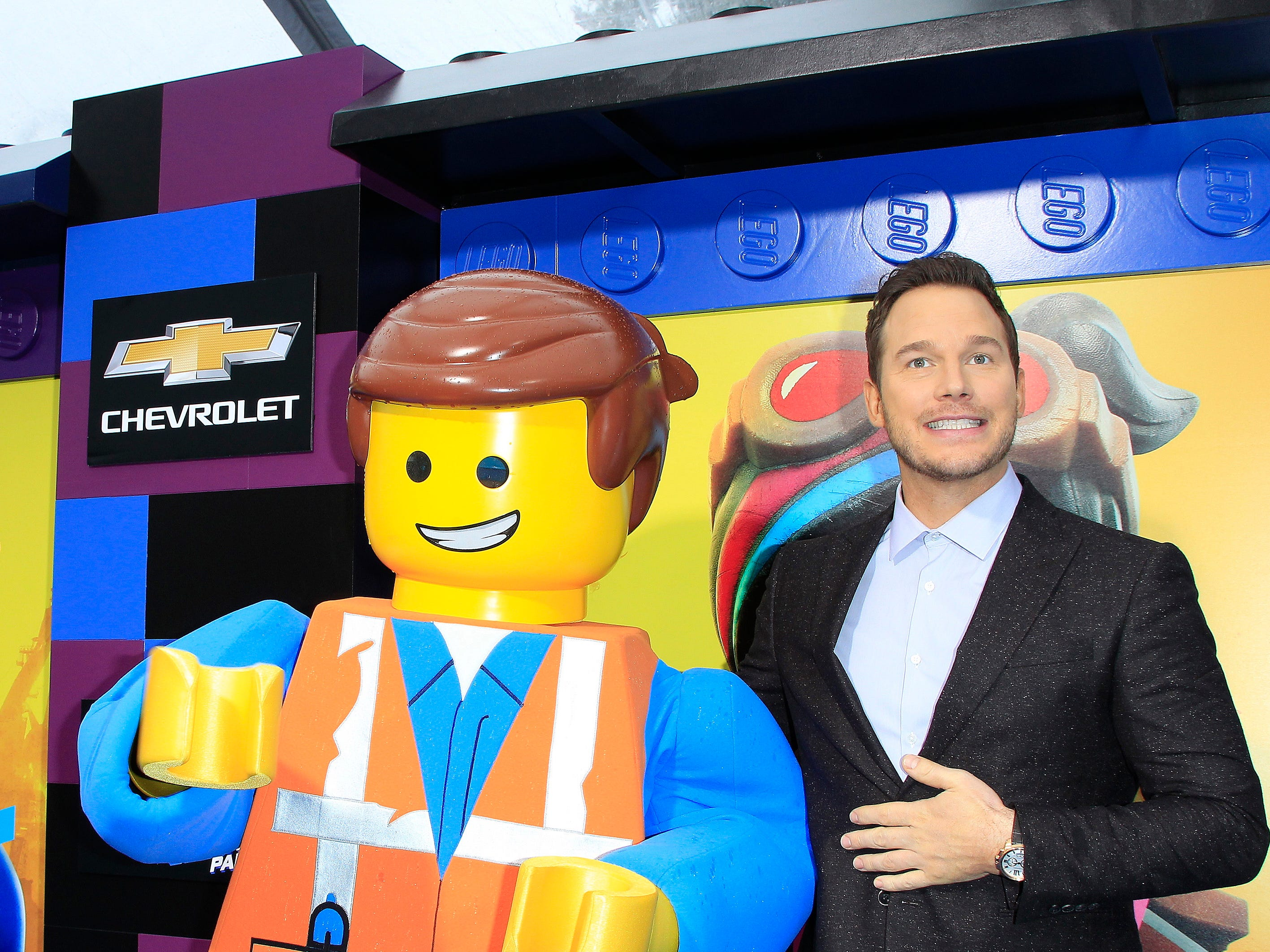 "Chris Pratt poses with his character at the Feb. 2, 2019, premiere of ""The Lego Movie 2"" in Los Angeles, though photographers and celeb-watchers would probably have preferred to see fiancee Katherine Schwarzenegger by his side instead."
