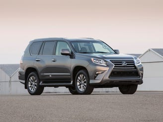 The highest ranked midsize premium SUV is the Lexus GX.