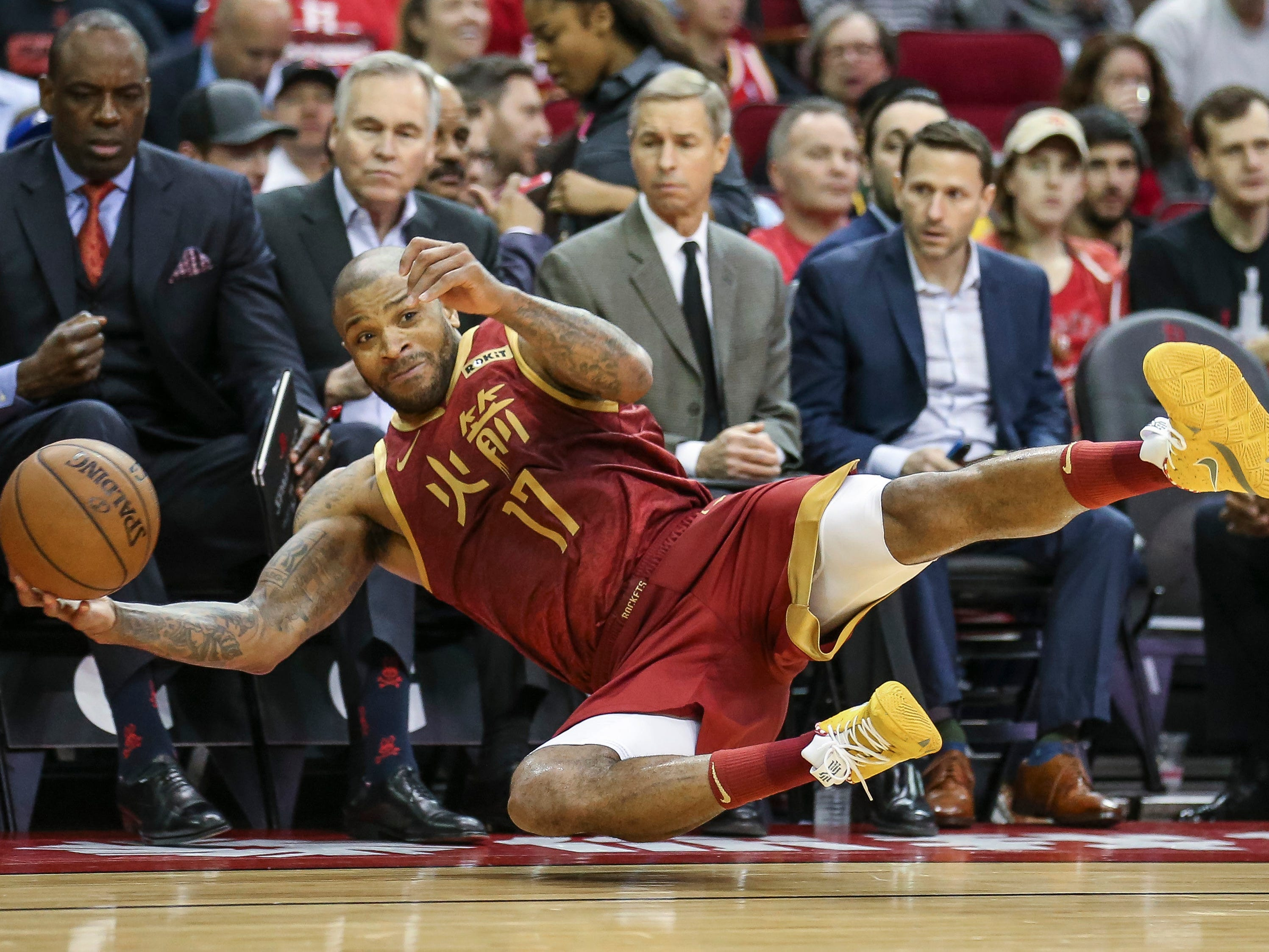 Feb. 11: Rockets forward P.J. Tucker hits the deck to save a loose ball from going out of bounds during the second half against the Mavericks in Houston.