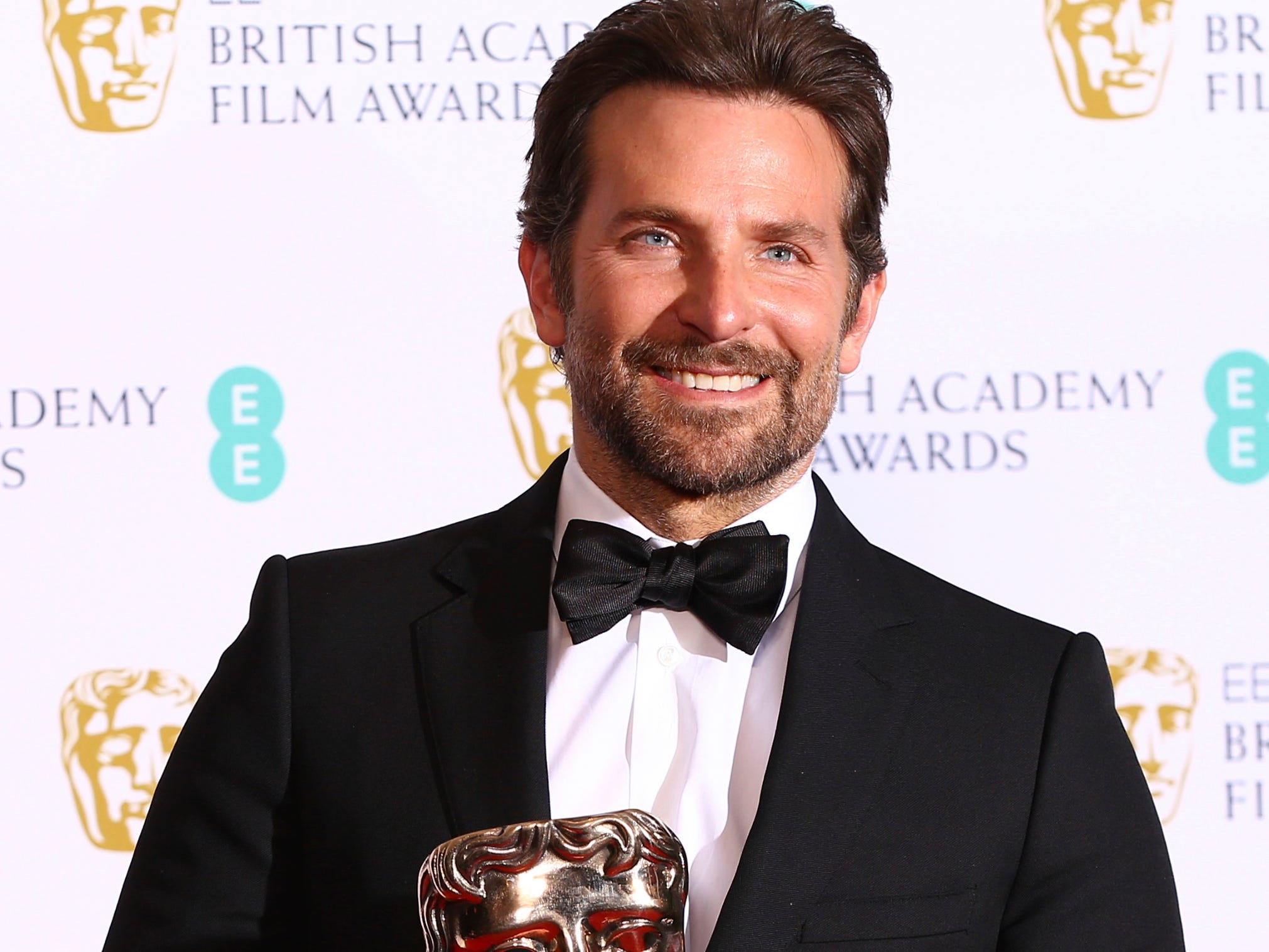 "Hours earlier and an ocean away, Gaga's co-star and director Bradley Cooper accepted the BAFTA equivalent of that award in London. In addition to thanking her, he gave a shout-out to girlfriend Irina Shayk for putting up with him while he ""tried to make music in the basement for a year."""