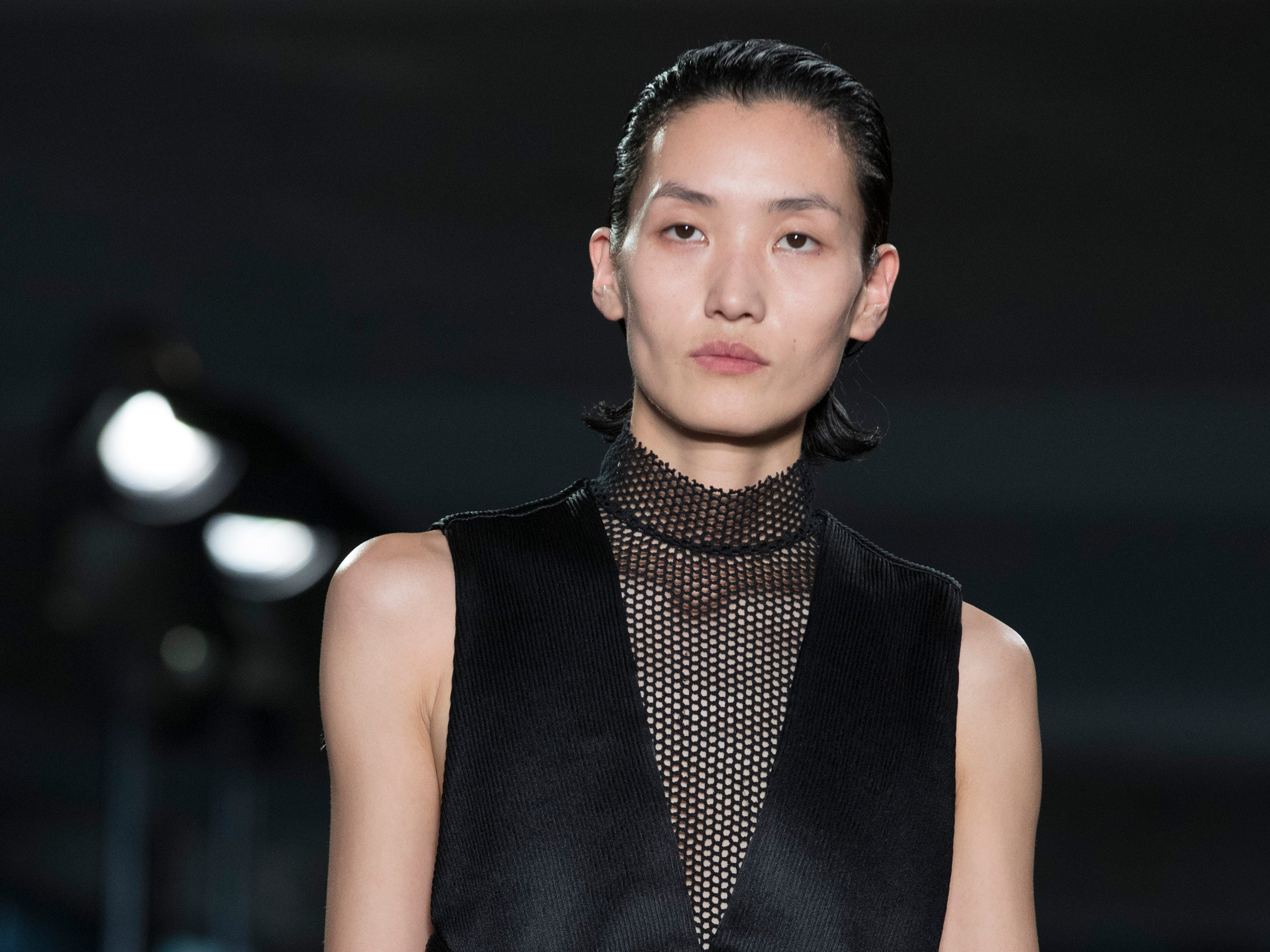Another Proenza Schouler look featured a black satin jumpsuit with tuxedo trim and mesh panels.
