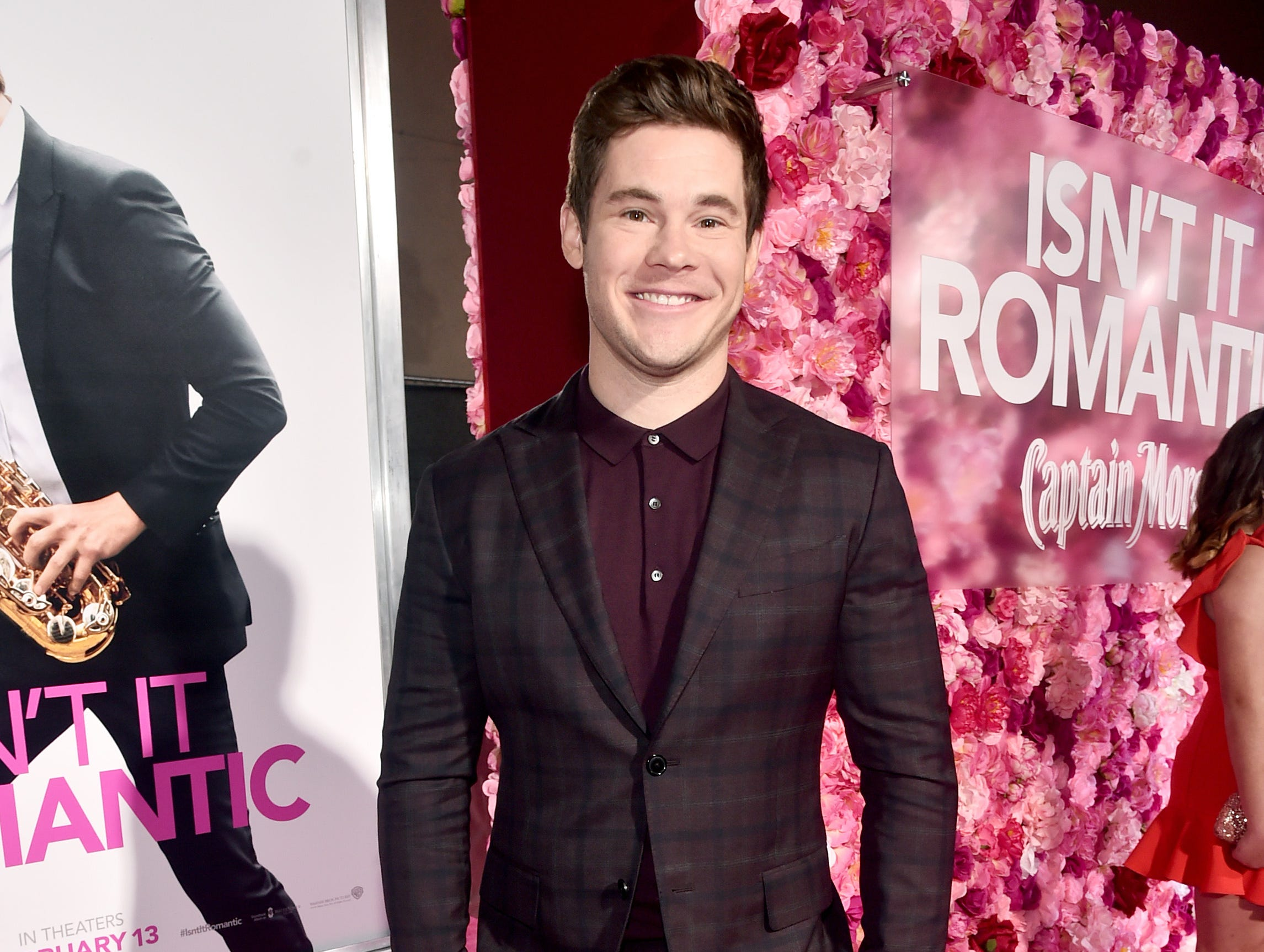 "LOS ANGELES, CALIFORNIA - FEBRUARY 11: Adam DeVine attends the premiere of Warner Bros. Pictures' ""Isn't It Romantic"" at The Theatre at Ace Hotel on February 11, 2019 in Los Angeles, California. (Photo by Alberto E. Rodriguez/Getty Images) ORG XMIT: 775292839 ORIG FILE ID: 1129040957"