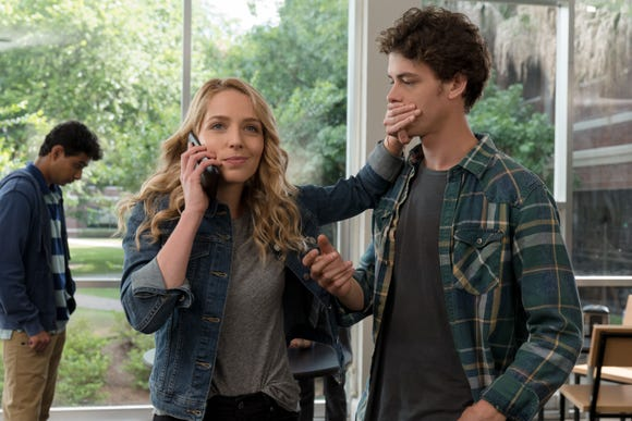 "Tree (Jessica Rothe) and Carter (Israel Broussard) are a new couple dealing with changes in their relationship in ""Happy Death Day 2U."""