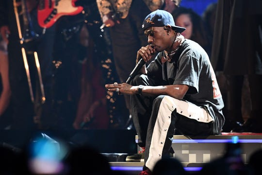 Travis Scott was onstage to perform at Sunday's 61st Annual Grammy Awards, but not to accept any trophies.