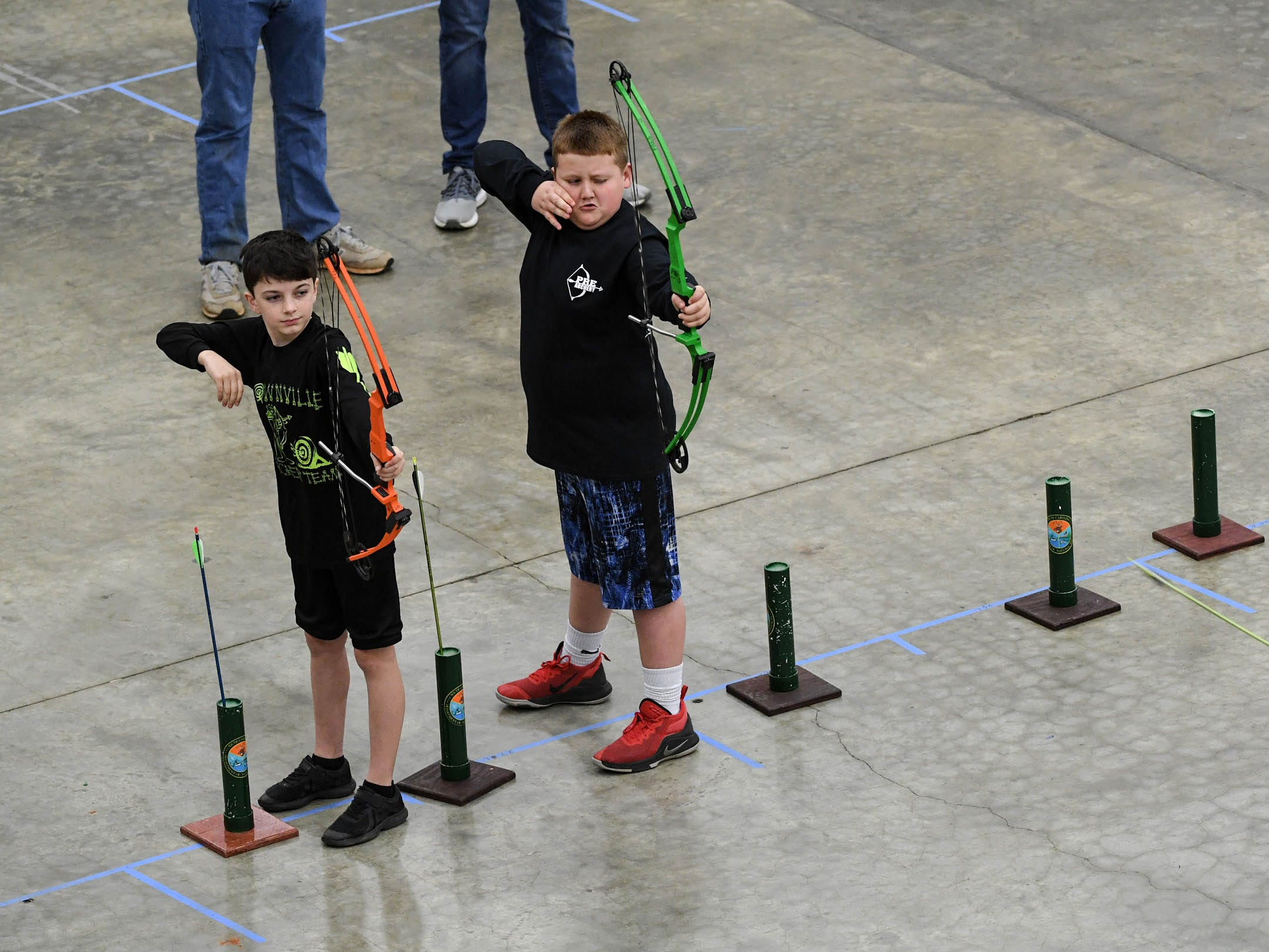 Students release arrows toward their target during the South Carolina Department of Natural Resources regional National Archery in the Schools Program (NASP) regional competition at the Anderson Civic Center Wednesday.