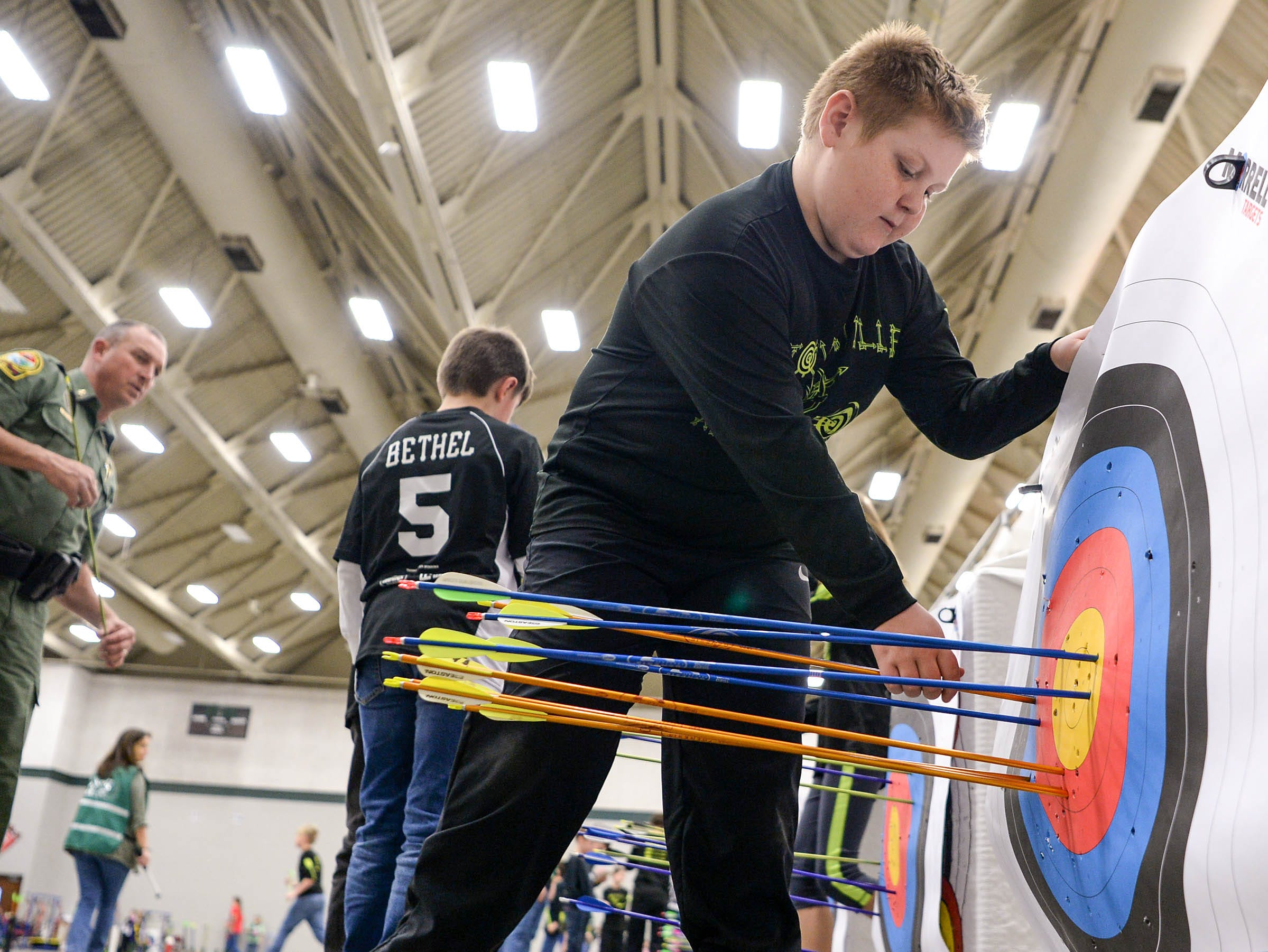 Deaven Alewine, a fourth-grade Townville Elementary School student, pulls one of his five arrow shafts from the target during the South Carolina Department of Natural Resources regional National Archery in the Schools Program (NASP) regional competition at the Anderson Civic Center Wednesday.  The program, which awards $50,000 in scholarships to high school seniors, is a joint venture between state departments of Education and Wildlife. The competition in Anderson, leading up to the state finals March 26-28 in Sumter, had 950 children from 14 elementary and 23 high schools around the state. Pendelton High School finished first in the IBO competition and second in the bullseye for the high school division, while Riverside Middle School in Pendleton finished first in the IBO and bullseye competitions for middle schools.