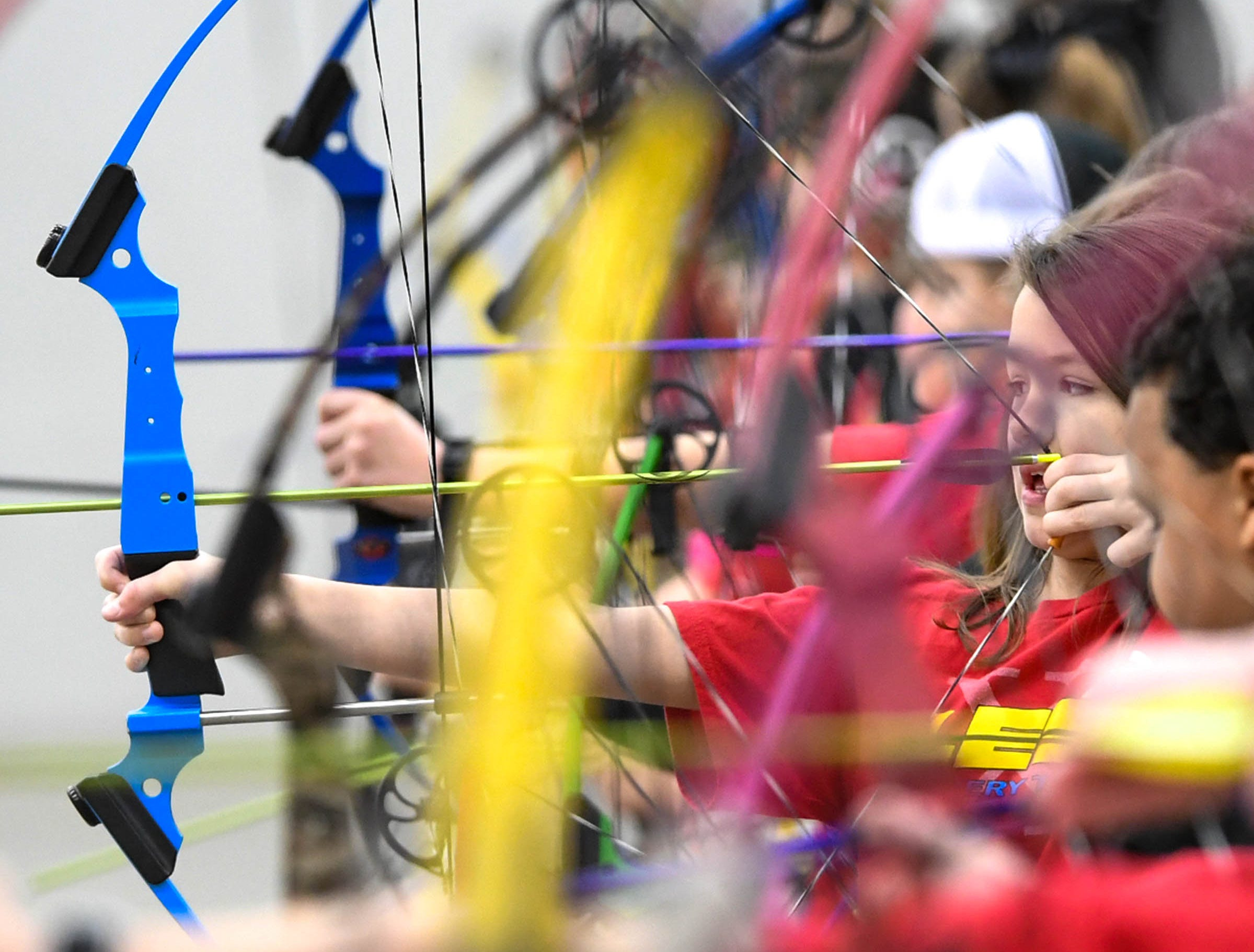 Jayda Masters, a fourth-grade LaFrace Elementary School student, gets ready to release an arrow during the South Carolina Department of Natural Resources regional National Archery in the Schools Program (NASP) regional competition at the Anderson Civic Center Wednesday.  The program, which awards $50,000 in scholarships to high school seniors, is a joint venture between state departments of Education and Wildlife. The competition in Anderson, leading up to the state finals March 26-28 in Sumter, had 950 children from 14 elementary and 23 high schools around the state.