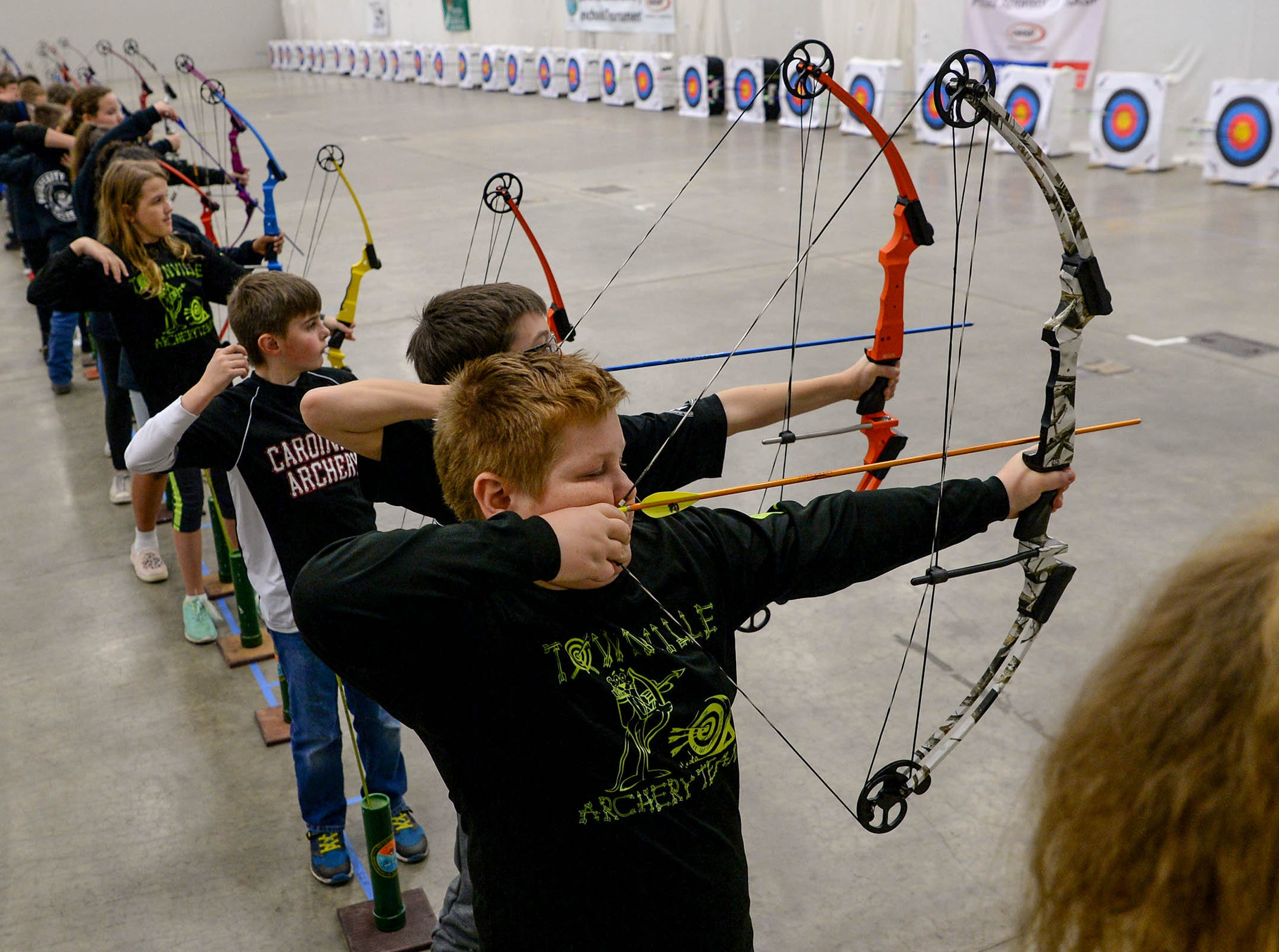 Deaven Alewine, a fourth-grade Townville Elementary School student, gets ready to release one of his five arrow shafts toward his target during the South Carolina Department of Natural Resources regional National Archery in the Schools Program (NASP) regional competition at the Anderson Civic Center Wednesday.  The program, which awards $50,000 in scholarships to high school seniors, is a joint venture between state departments of Education and Wildlife. The competition in Anderson, leading up to the state finals March 26-28 in Sumter, had 950 children from 14 elementary and 23 high schools around the state.  Pendelton High School finished first in the IBO competition and second in the bullseye for the high school division, Riverside Middle School in Pendleton finished first in the IBO and bullseye competitions for middle schools, and LaFrance Elementary team finished first.