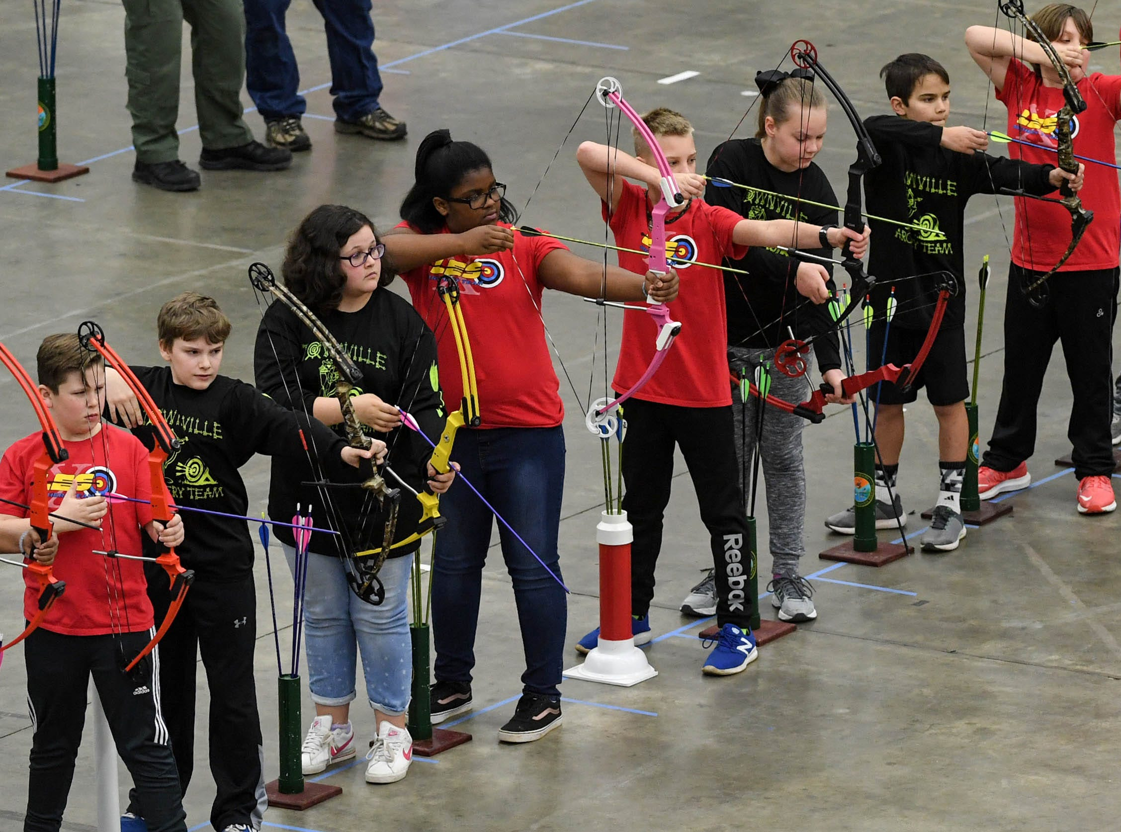 Students get ready to release arrows during the South Carolina Department of Natural Resources regional National Archery in the Schools Program (NASP) regional competition at the Anderson Civic Center Wednesday.  The program, which awards $50,000 in scholarships to high school seniors, is a joint venture between state departments of Education and Wildlife. The competition in Anderson, leading up to the state finals March 26-28 in Sumter, had 950 children from 14 elementary and 23 high schools around the state.