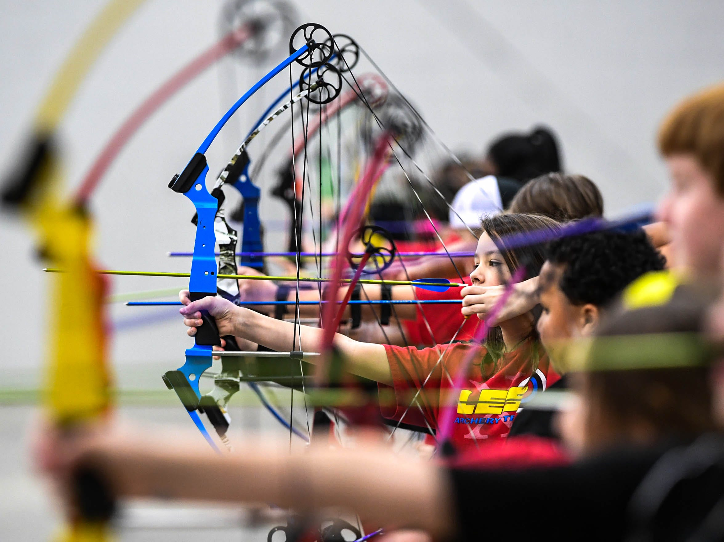 Jayda Masters, a fourth-grade LaFrace Elementary School (Anderson School District 4) student, gets ready to release an arrow during the South Carolina Department of Natural Resources regional National Archery in the Schools Program (NASP) regional competition at the Anderson Civic Center Wednesday.  The program, which awards $50,000 in scholarships to high school seniors, is a joint venture between state departments of Education and Wildlife. The competition in Anderson, leading up to the state finals March 26-28 in Sumter, had 950 children from 14 elementary and 23 high schools around the state. Pendelton High School finished first in the IBO competition and second in the bullseye for the high school division, Riverside Middle School in Pendleton finished first in the IBO and bullseye competitions for middle schools, and LaFrance Elementary team finished first.