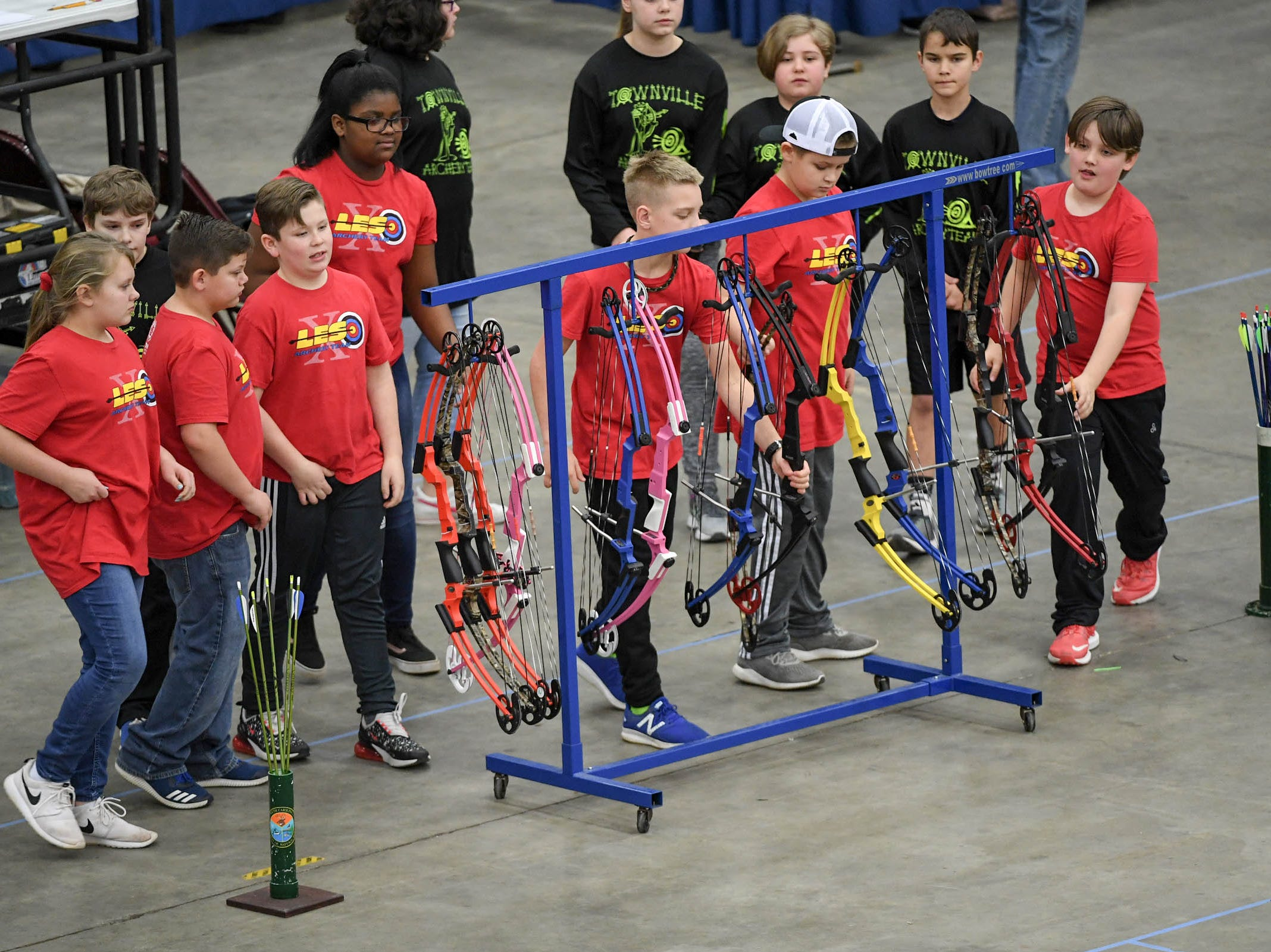 Students approach their bows during the South Carolina Department of Natural Resources regional National Archery in the Schools Program (NASP) regional competition at the Anderson Civic Center Wednesday.