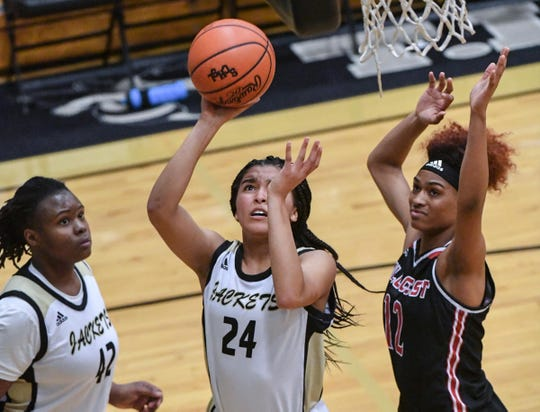 TL Hanna junior Maleia Bracone(24) shoots around Hillcrest junior Ayonnah Harris during the third quarter at T.L.Hanna High School in Anderson on Tuesday.