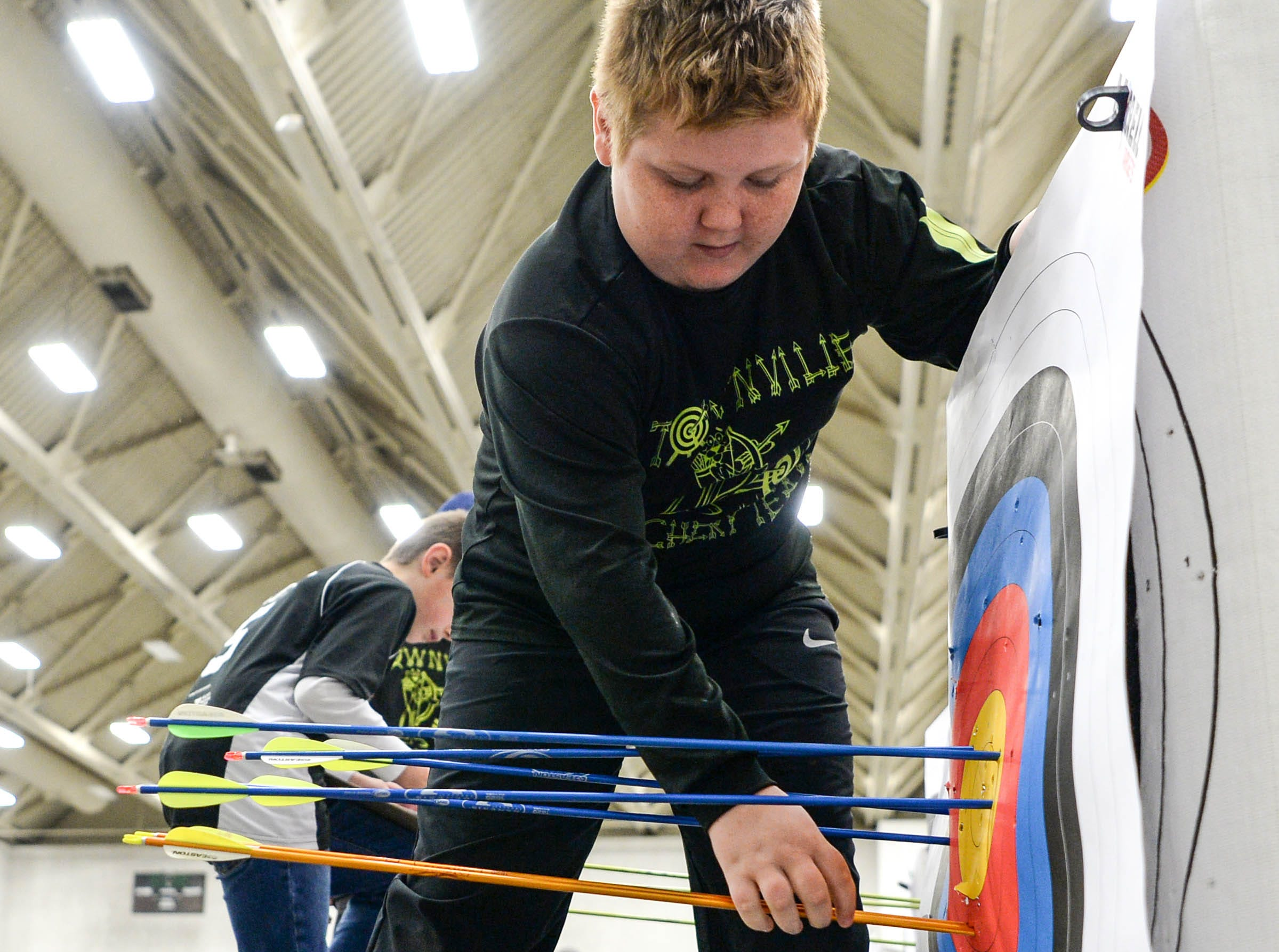Deavan Alewine, a fourth-grade Townville Elementary School student, pulls one of his five arrow shafts from the target during the South Carolina Department of Natural Resources regional National Archery in the Schools Program (NASP) regional competition at the Anderson Civic Center Wednesday.  The program, which awards $50,000 in scholarships to high school seniors, is a joint venture between state departments of Education and Wildlife. The competition in Anderson, leading up to the state finals March 26-28 in Sumter, had 950 children from 14 elementary and 23 high schools around the state.