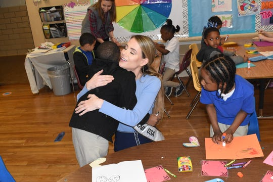 Miss Louisiana USA Victoria Paul of Alexandria visits a class of Kindergarten students at D.F. Huddle Elementary School Wednesday, Feb. 13, 2019. Paul is friends with their teacher Madeline Brown. She helped the children color cards and inspiration pages that she will take to the Alexandria VA Medical Center to share with veterans. Paul visited with other Kindergarten pre-Kindergarten students. Paul brought this project up to the Rapides Parish School Board because art is a great to connect with children and a good way to encourage them to be kind.