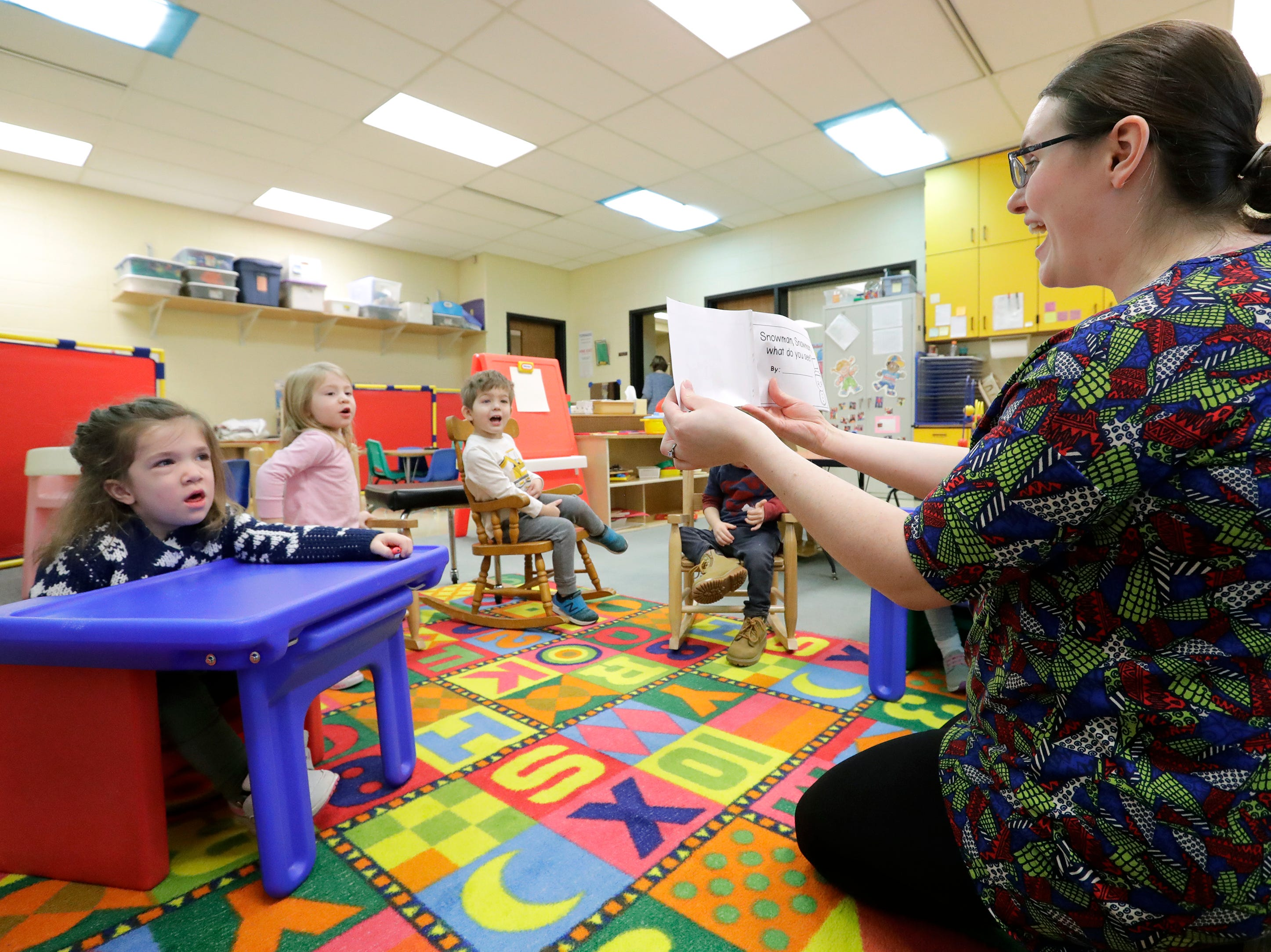 Avi Brennan, left, answers a question by speech-language pathologist Deirdre Floros during a class speech therepy session Monday, Jan. 7, 2019, at the Washington School of Early Learning in Neenah, Wis.