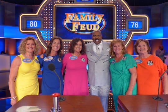 "The Randerson sisters from Freedom — Jo Ann Randerson, Maureen Vanden Heuvel, Patti Peters, Barb Gerritts and Mary Talbot — stand with host Steve Harvey on the set of ""Family Feud."""